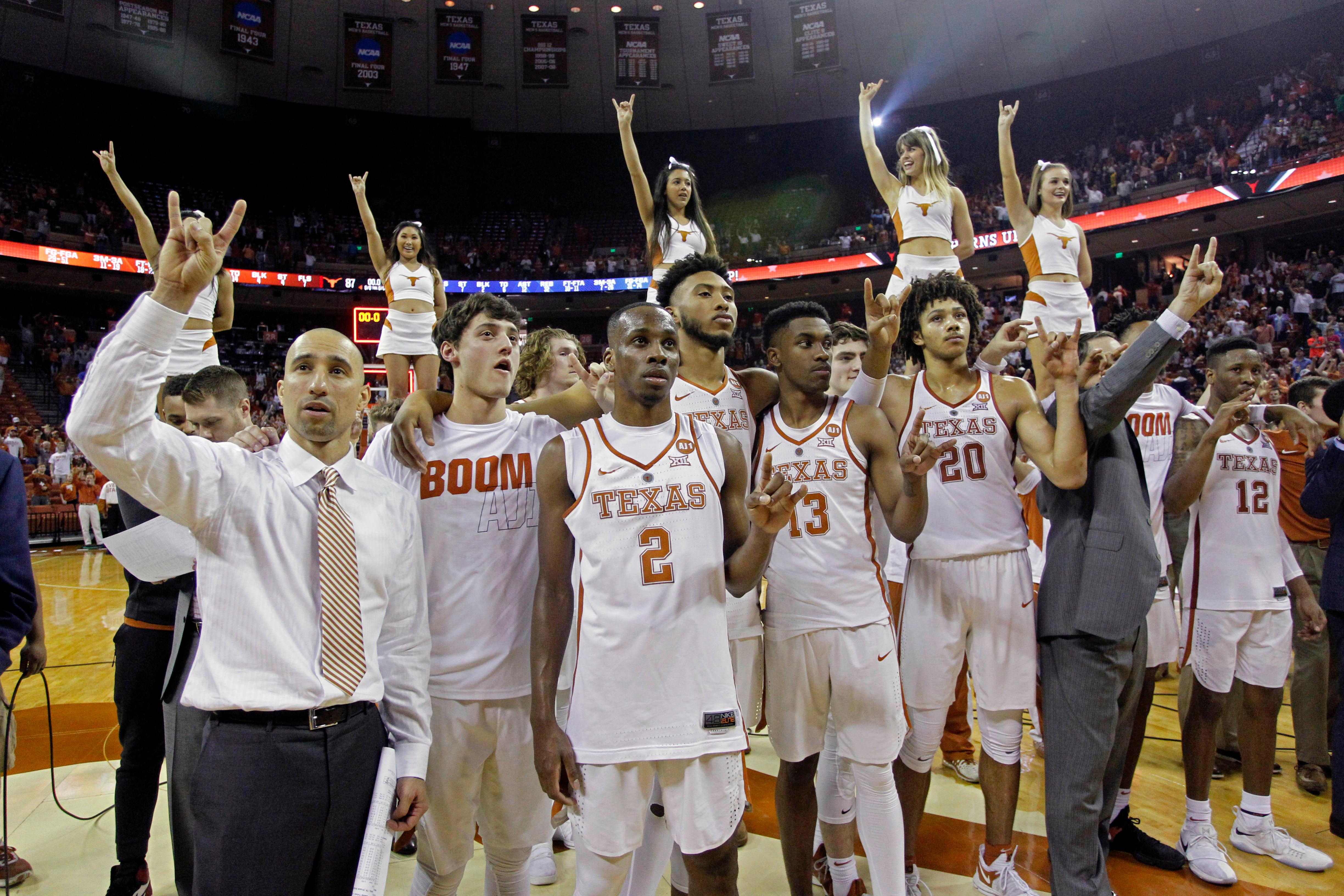 "FILE - In this March 3, 2018, file photo, Texas head coach Shaka Smart, left, sings the ""Eyes of Texas"" with his team after defeating West Virginia 87-79 in an NCAA college basketball game, in Austin, Texas. Through each game since early January, win or lose, the Texas Longhorns have insisted teammate Andrew Jone has been with them every step of the way as they their fought to return to the NCAA Tournament. So much so, that when it came time to see if their name would be called, the Longhorns dialed up Jones, who is in Houston for leukemia treatments, on a video conference call to listen and watch together.(AP Photo/Michael Thomas, File)"