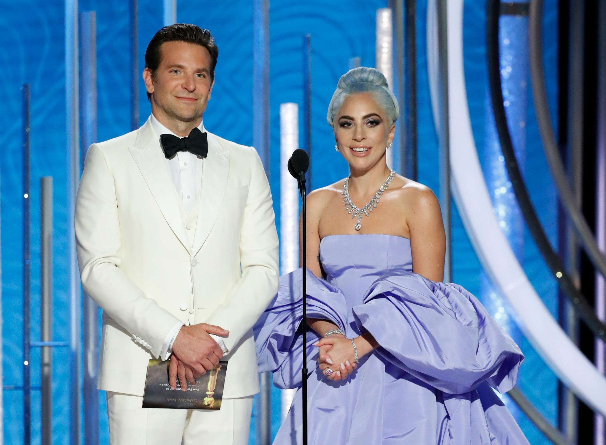 This image released by NBC shows Bradley Cooper, left, and Lady Gaga presenting the award for best actor in a TV comedy series at the 76th Annual Golden Globe Awards at the Beverly Hilton Hotel on Sunday, Jan. 6, 2019, in Beverly Hills, Calif. (Paul Drinkwater/NBC via AP)