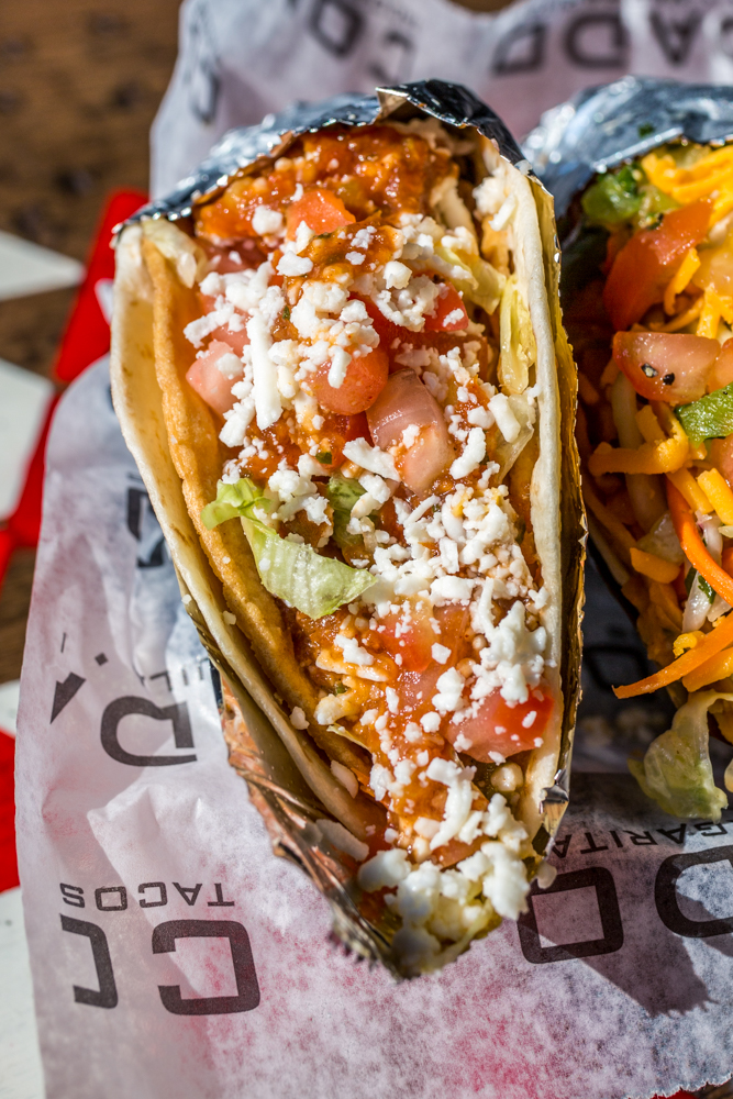 El Santo: Sweet Lucy shell (flour soft, corn hard, queso, and guac) filled with roasted chicken, lettuce, tomatoes, queso fresco, salsa roja, and Condado secret taco sauce / Image: Catherine Viox{ }// Published: 6.9.19