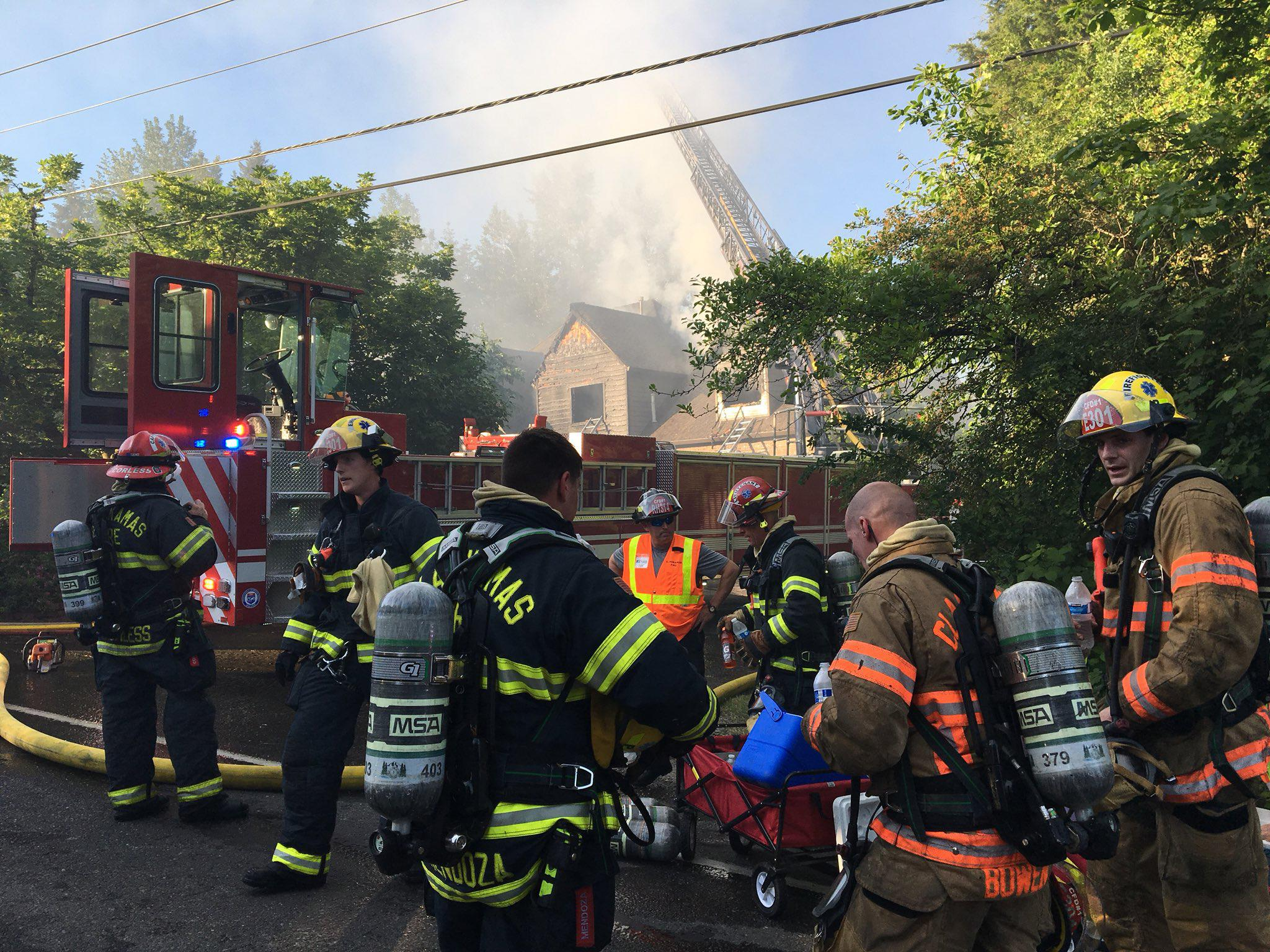 Clackamas firefighters grab liquids and rest as other crews arrive to help them fight a house fire on Mt. Scott Boulevard in Happy Valley Monday evening. (Photo: Clackamas Fire)