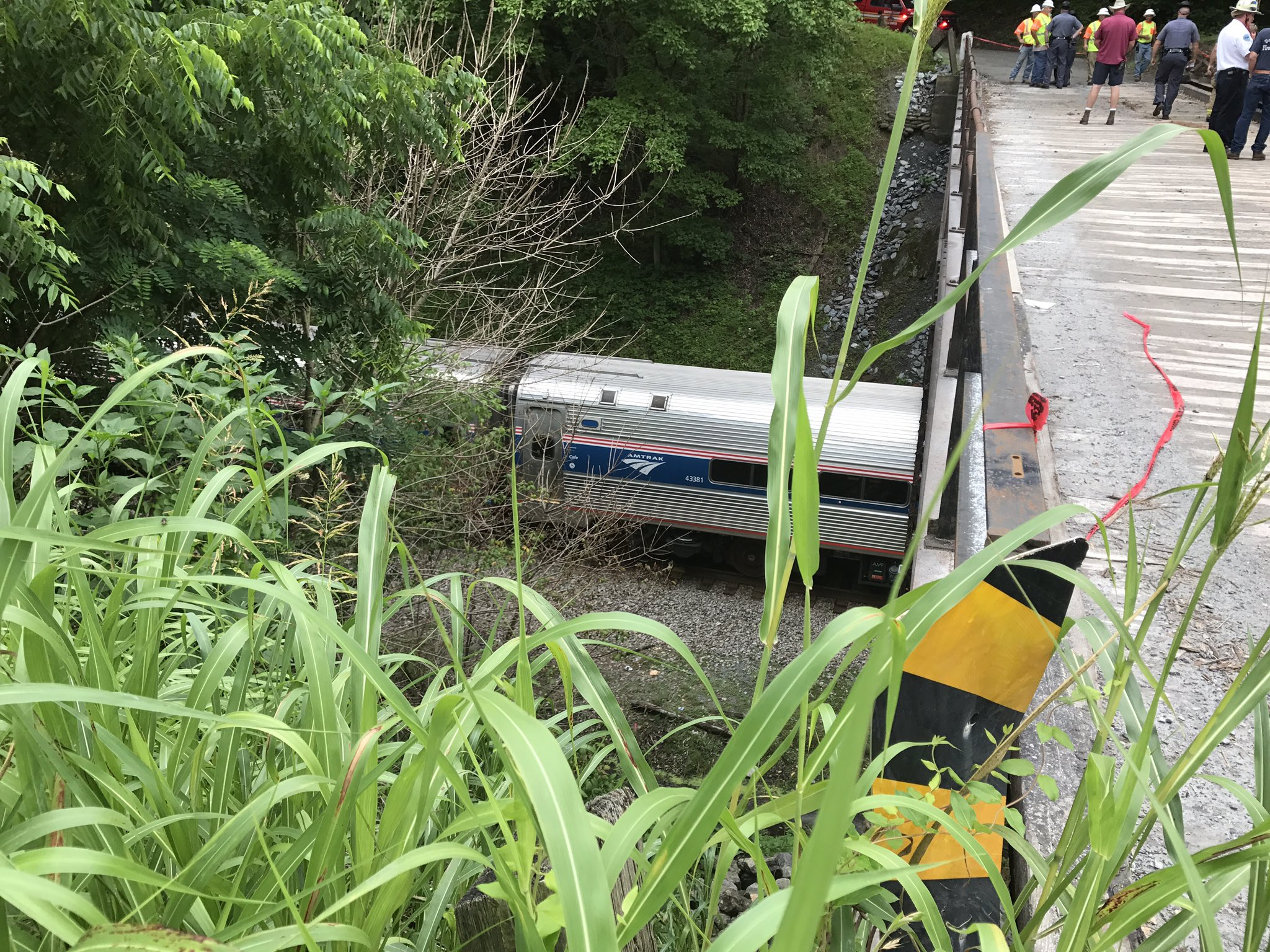 The Amtrak train is still at the scene below the bridge (Photo: Chris Hoffman)