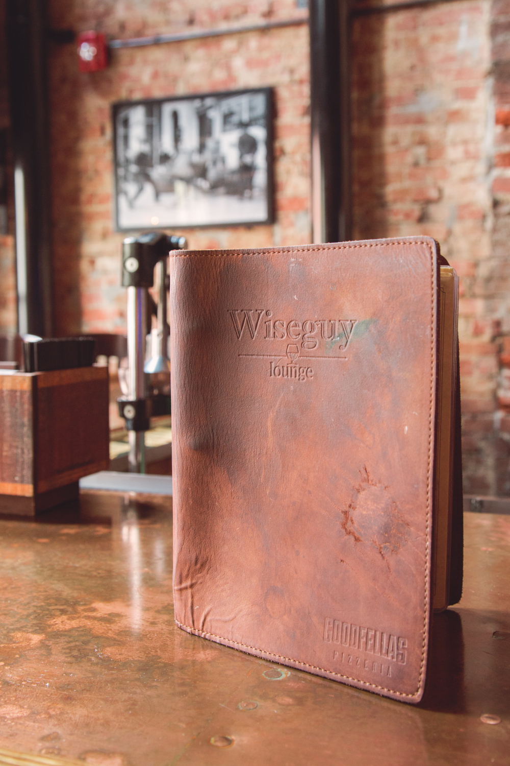 The Over-the-Rhine location of Wiseguy Lounge, located above Goodfellas Pizzeria, is a local speakeasy that features an enormous selection of bourbon and colorful cocktails mixed by experienced barkeeps in Prohibition Era garb. It is located at 1211 Main Street Cincinnati, OH 45202. / Image: Catherine Viox