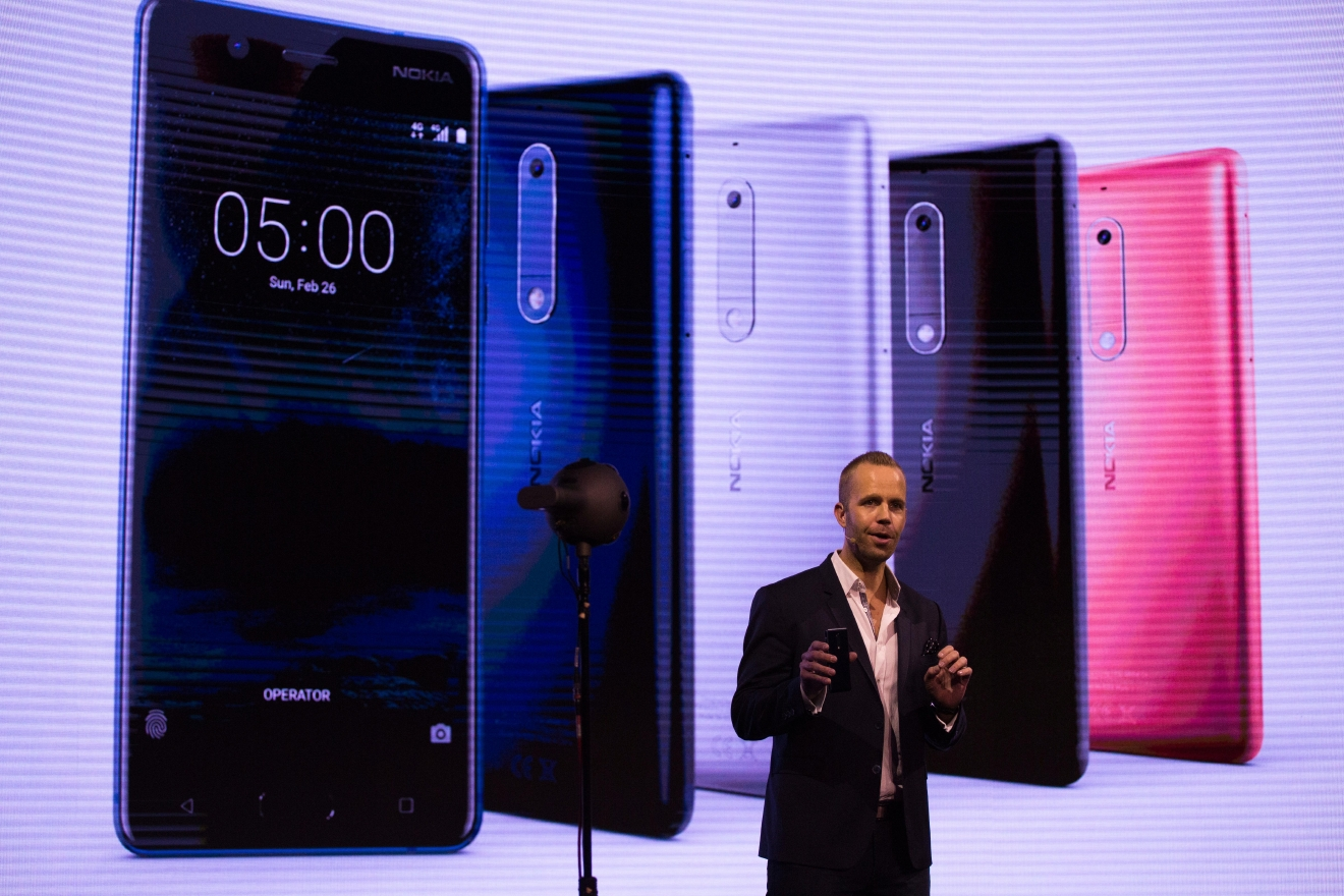Juho Sarvikas, Chief Product Officer of HMD Global, shows the new Nokia 5 smartphone, ahead of Monday's opening of the Mobile World Congress wireless show in Barcelona, Spain, Sunday, Feb. 26, 2017. Finland-based HMD Global is re-launching the simple Nokia 3310 model along with unveiling three new devices at Mobile World Congress in Barcelona. (AP Photo/Emilio Morenatti)