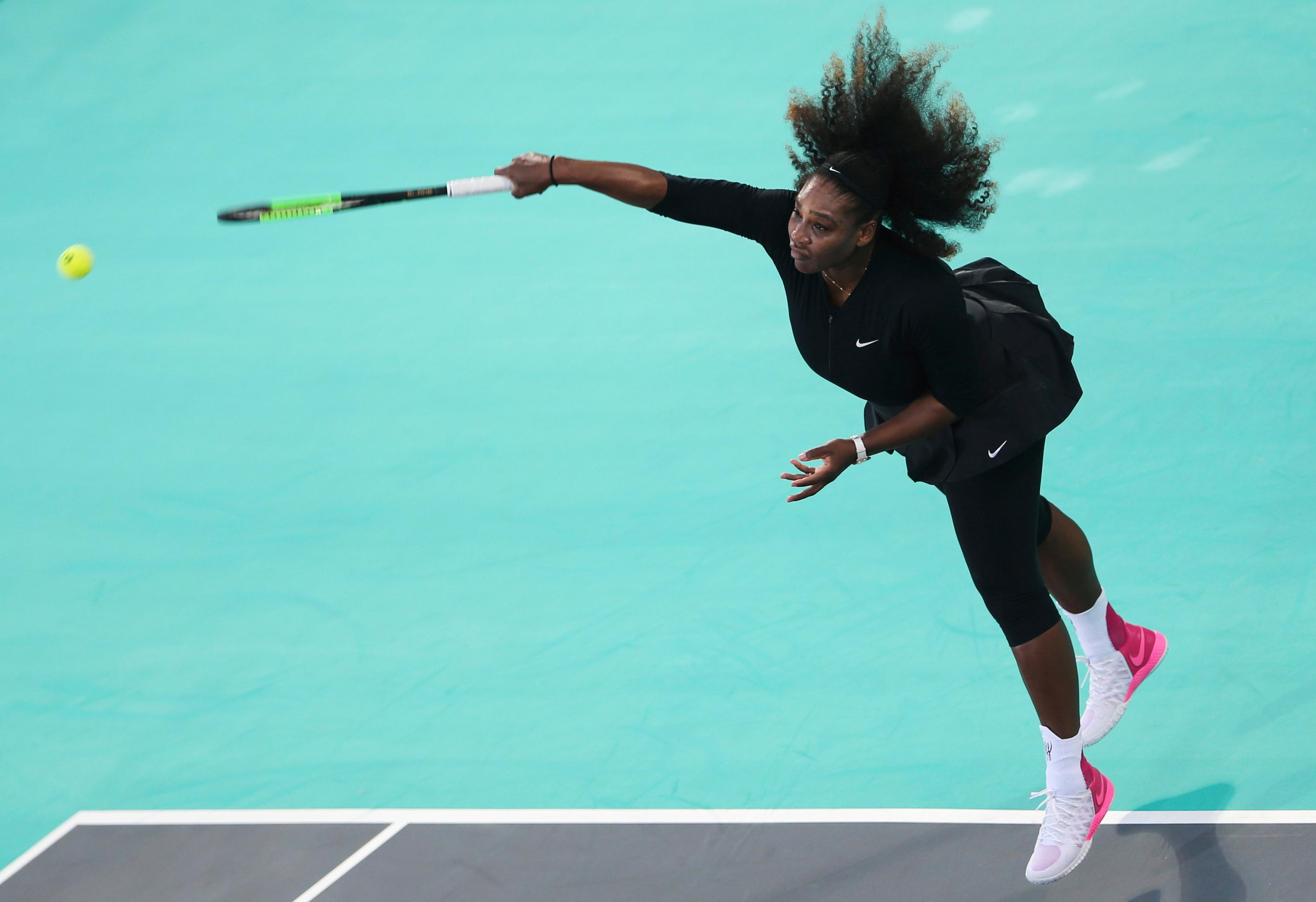 Serena Williams, of the U.S., serves the ball to Jelena Ostapenko, of Latvia, during the final day of the Mubadala World Tennis Championship in Abu Dhabi, United Arab Emirates, Saturday, Dec. 30, 2017. (AP Photo/Kamran Jebreili)