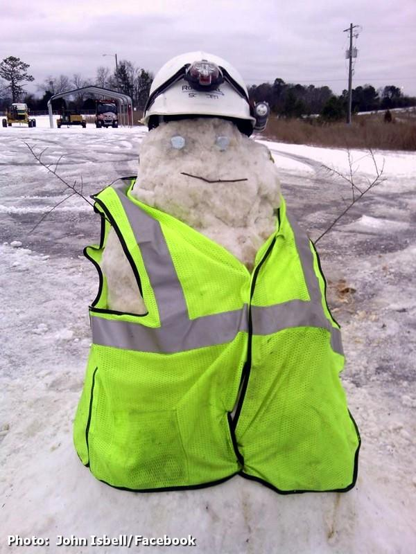 Snowman helps with road and rail safety in Alabama during a winter storm, Tuesday, January 28, 2014.