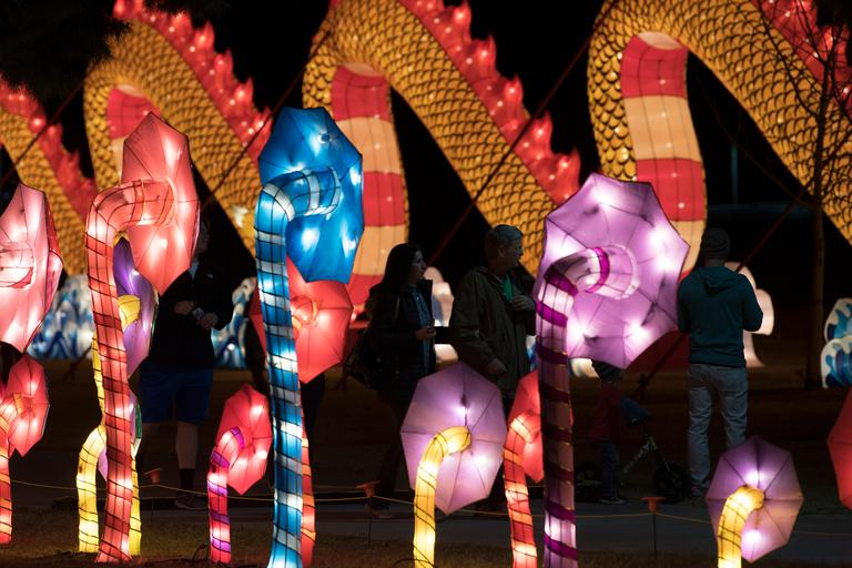 People stroll walkways between lanterns on the opening night of the China Lights lantern festival Friday, January 19, 2018, at Craig Ranch Regional Park in North Las Vegas. The festival, which features nearly 50 silk and LED light displays comprised of over 1000 elements, runs through February 25th. CREDIT: Sam Morris/Las Vegas News Bureau