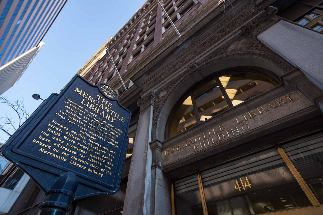 "A historical marker is placed next to the door of the Mercantile Library that very briefly highlights parts of its history. It was placed there in 1998 and became the city's first ""Historic Cincinnati"" sign to label local places of note. / Image: Phil Armstrong, Cincinnati Refined // Published: 2.7.18"