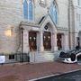 Car crashes and flips over in front of Alexandria church, driver hospitalized, police say