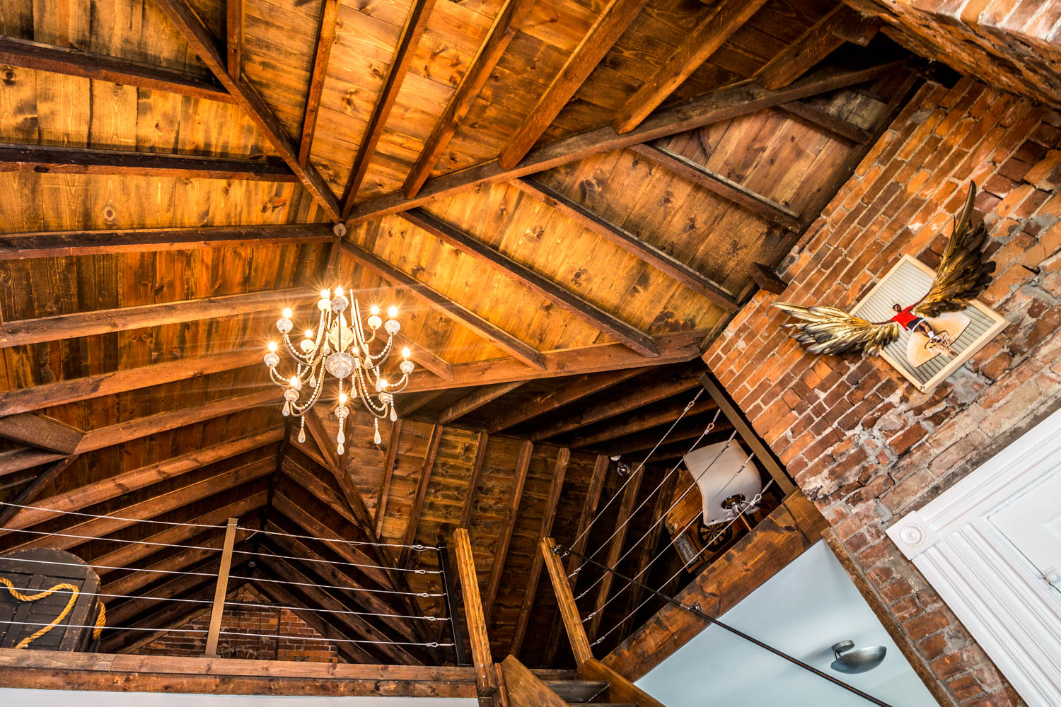 Discovering the loft was a very memorable moment of the rehab for the Lehmans. When they bought the house, the space was covered with a drop ceiling, so they had no clue all of the additional square footage was up there. / Image: Catherine Viox // Published: 10.13.19