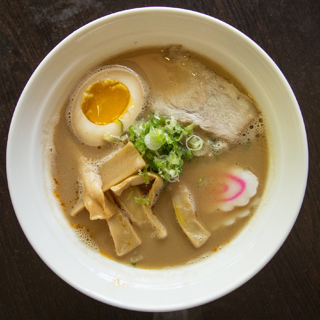 This isn't just any ramen. This ramen is made with a special tonkotsu broth. & That broth is cooked for over twelve hours with Berkshire pork. (Respect.) / Image: Catherine Viox