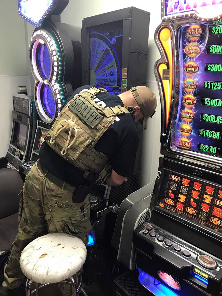 Deputies seized gambling machines and more than $11,000 in a raid at the Alligator Express on Ross Sterling Avenue. (Photo provided by the Chambers County Sheriff's Office)
