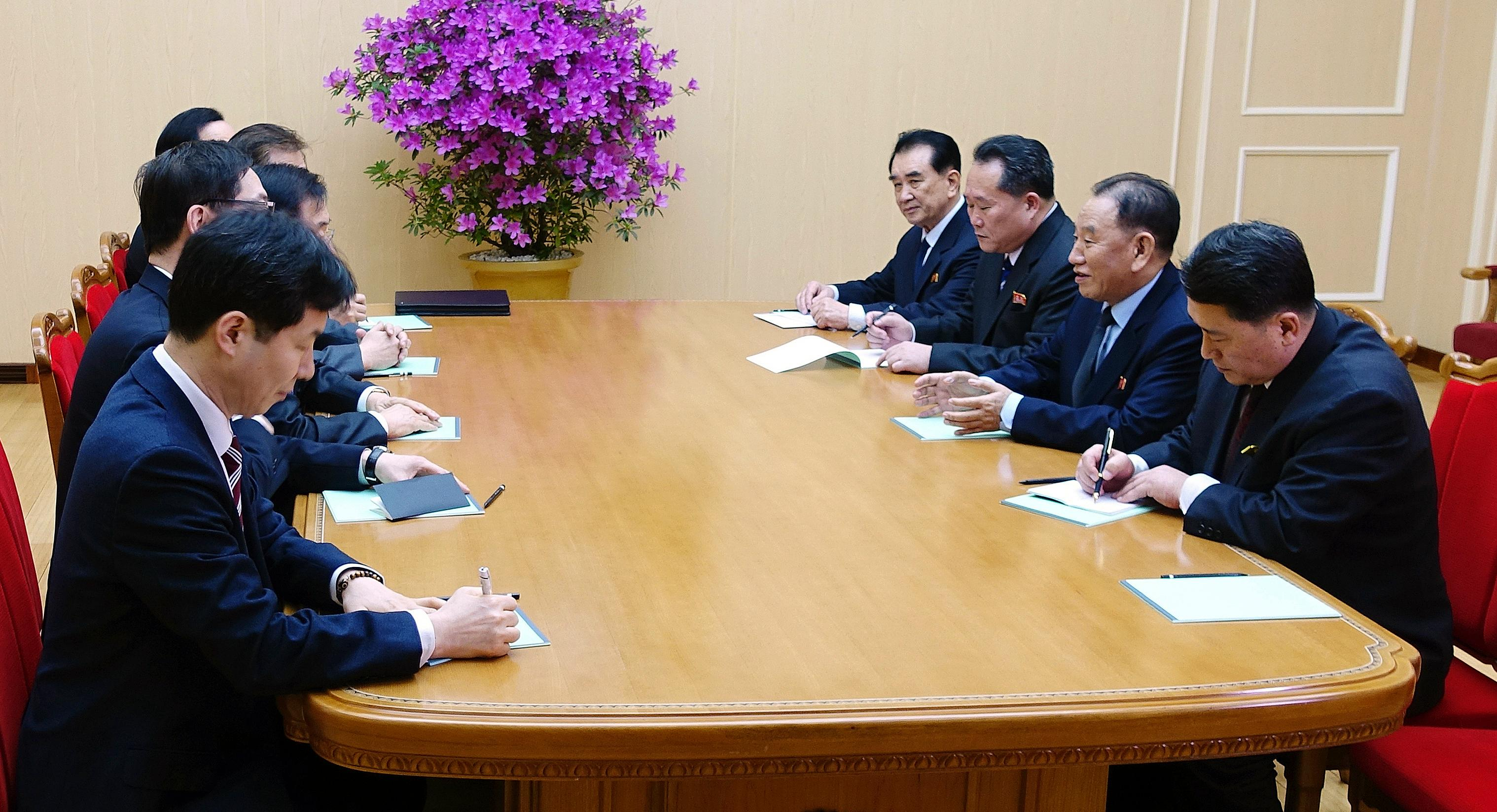 In this photo provided by South Korea Presidential Blue House via Yonhap News Agency, Kim Yong Chol, vice chairman of North Korea's ruling Workers' Party Central Committee, second from right, talks with South Korean delegation in Pyongyang, North Korea, Monday, March 5, 2018.  Envoys for South Korean President Moon Jae-in, led by Moon's national security director, Chung Eui-yong, are on a rare two-day visit to Pyongyang that's expected to focus on how to ease a standoff over North Korea's nuclear ambitions and restart talks between Pyongyang and Washington. (South Korea Presidential Blue House/Yonhap via AP)