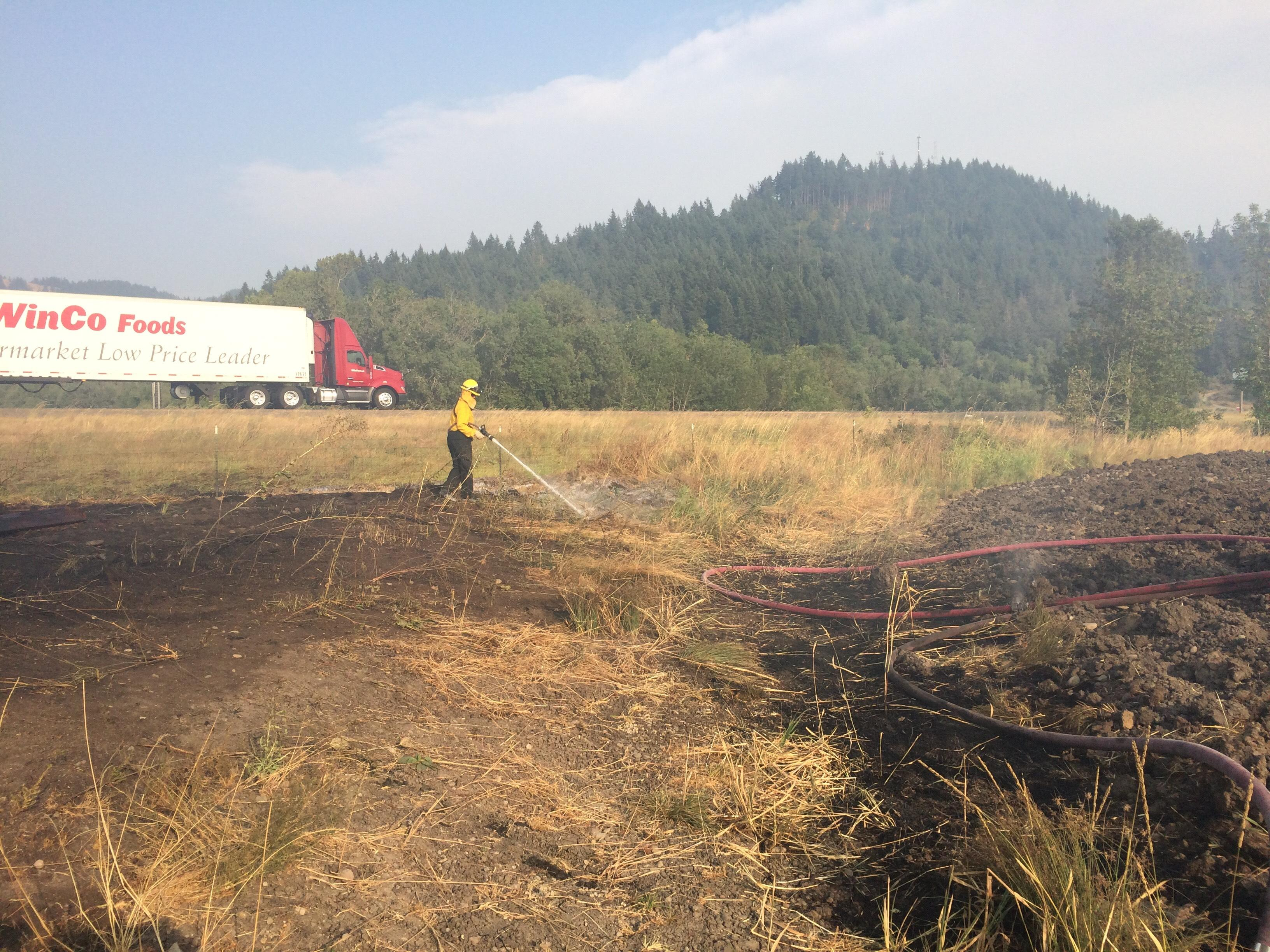 Firefighters held a field fire along Interstate 5 north of Beltline to about 7 acres Wednesday evening.  The fire will likely smolder into Thursday, officials said. (SBG)