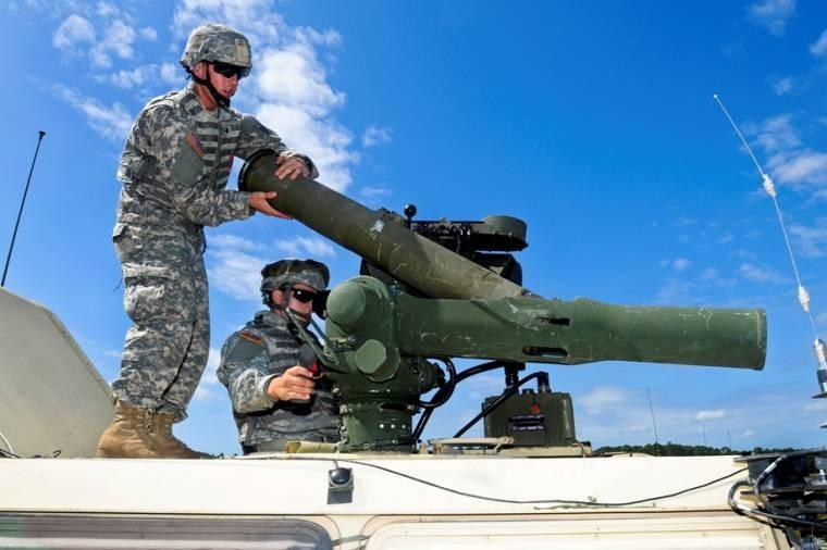 Army Spcs. Justin Reynolds, left, and Jon Haley reload a training round into an tow missile system during a live-fire exercise at the Georgia Garrison Training Center on Fort Stewart, Ga.