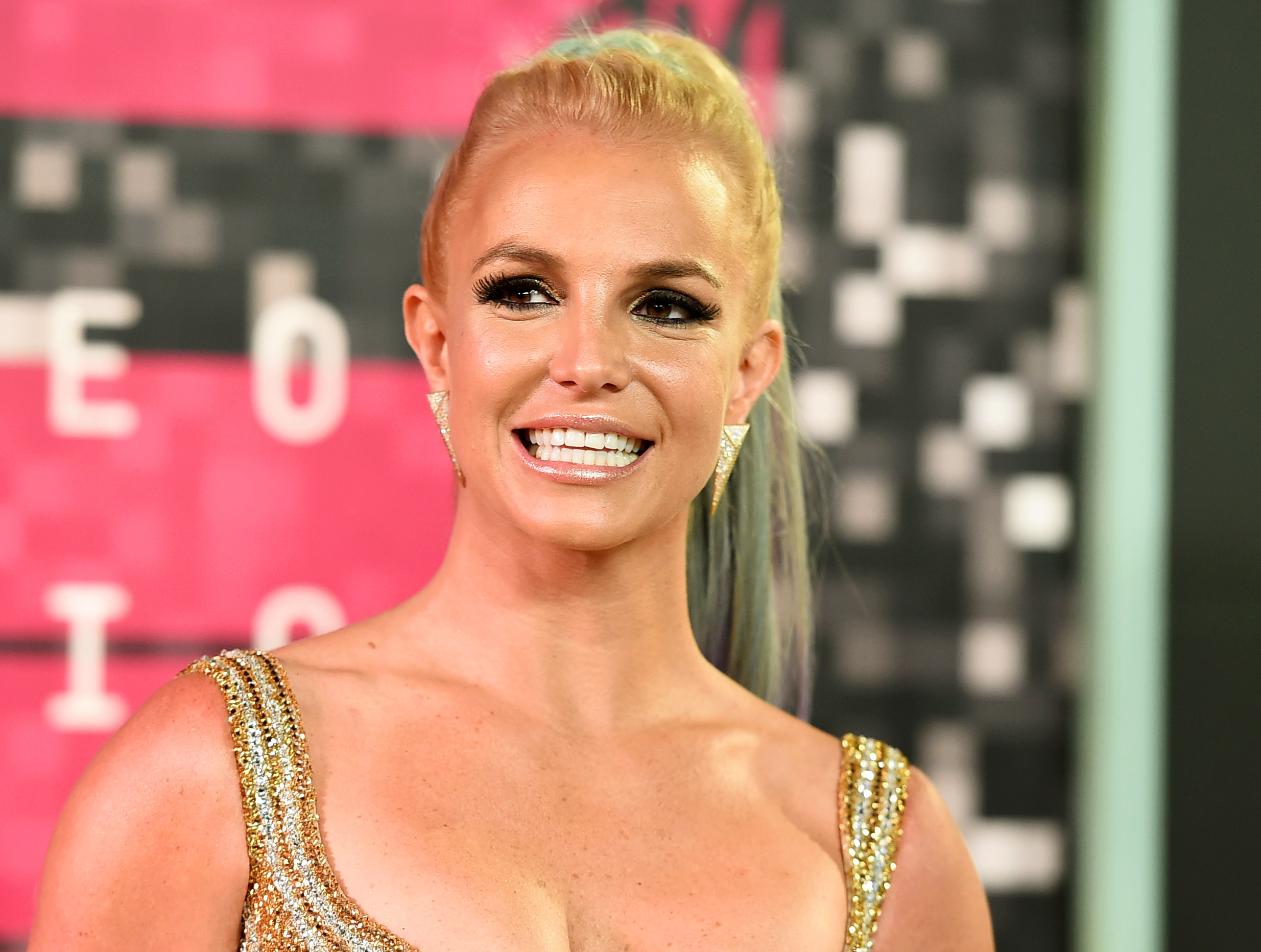 FILE - In this Aug. 30, 2015, file photo, Britney Spears arrives at the MTV Video Music Awards in Los Angeles. Spears, Elton John, Alicia Keys and Calvin Harris are among the performers at this year's Apple Music Festival, Apple announced the lineup Wednesday, Aug. 24, 2016. (Photo by Jordan Strauss/Invision/AP, File)