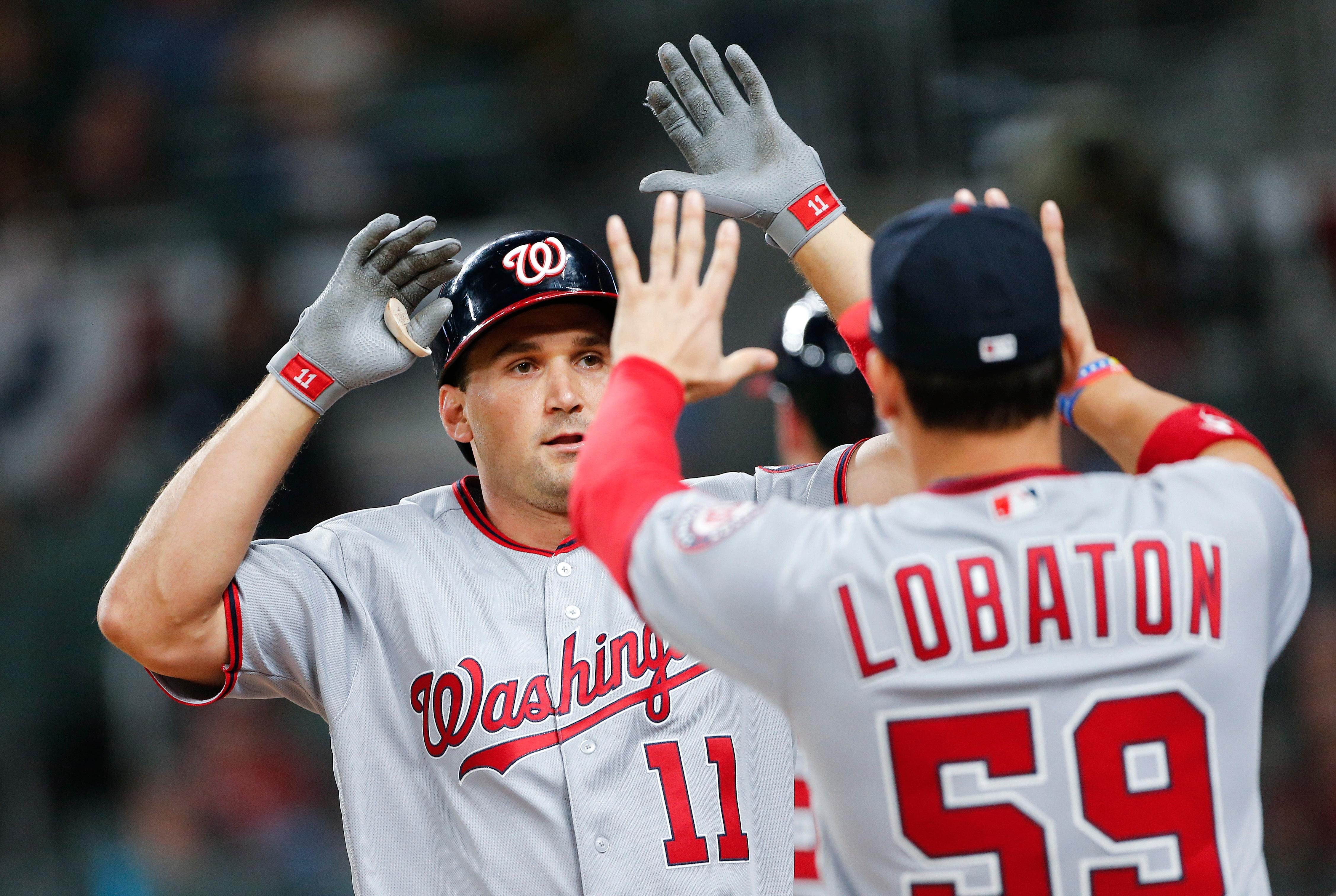 Washington Nationals' Ryan Zimmerman (11) celebrates with Jose Lobaton (59) after hitting a two-run home run during the sixth inning of a baseball game against the Atlanta Braves on Thursday, April 20, 2017, in Atlanta. (AP Photo/John Bazemore)