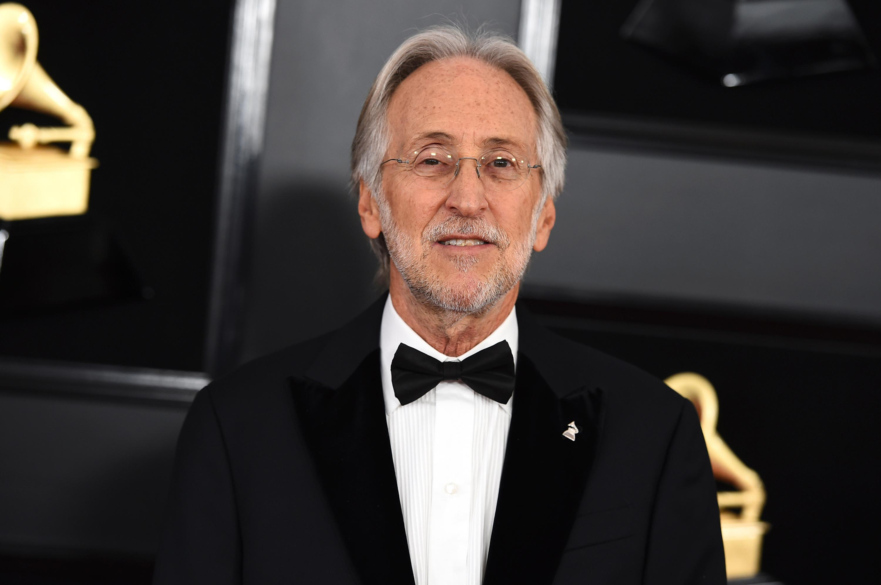 "FILE - This Feb. 10, 2019 file photo shows then President and CEO of The Recording Academy Neil Portnow at the 61st annual Grammy Awards in Los Angeles. Portnow says a rape allegation against him aired in a complaint against the Recording Academy by his successor is ""false and outrageous."" Portnow released a statement saying the academy during his tenure had conducted a thorough and independent investigation and he was ""completely exonerated."" (Photo by Jordan Strauss/Invision/AP, File)"
