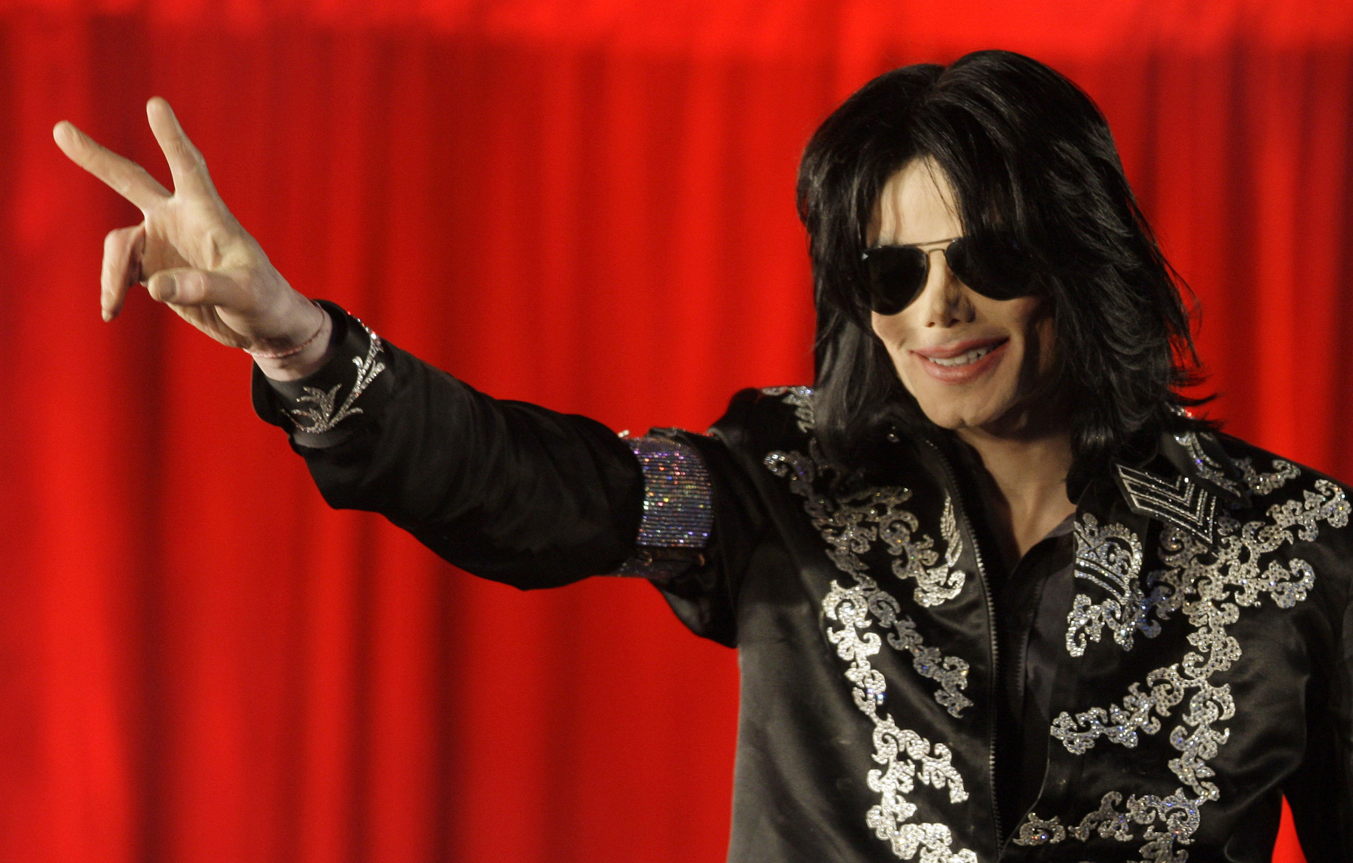 FILE - In this March 5, 2009, file photo, Michael Jackson appears at an event to announce a series of concerts in London. Forbes announced on Oct. 30, 2017, that Jackson topped its list of highest-earning dead celebrities. (AP Photo/Joel Ryan, File)