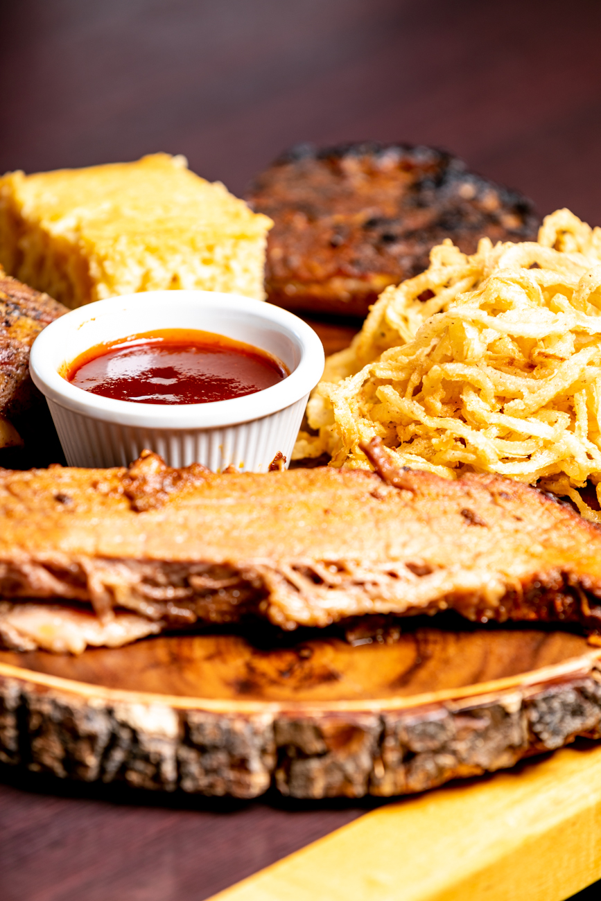 Ted's Platter: A combination of  original and  smoked ribs plus  slow-smoked brisket. Served with onion straws and cornbread / Image: Amy Elisabeth Spasoff // Published: 11.2.2018