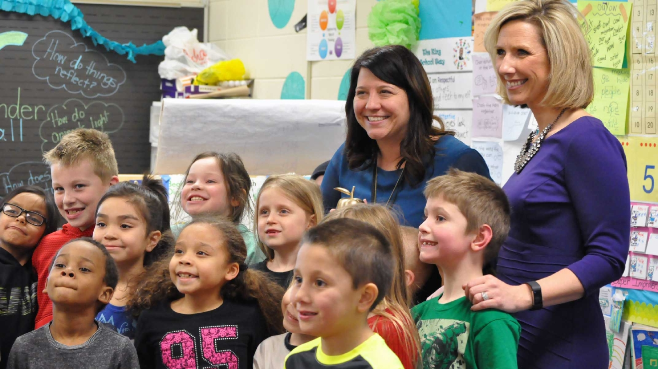 Golden Apple Award recipient Michelle Flicek poses with students and FOX 11's Michelle Melby March 8, 2017, at King Elementary School in Green Bay. (WLUK/Donna Fischer)