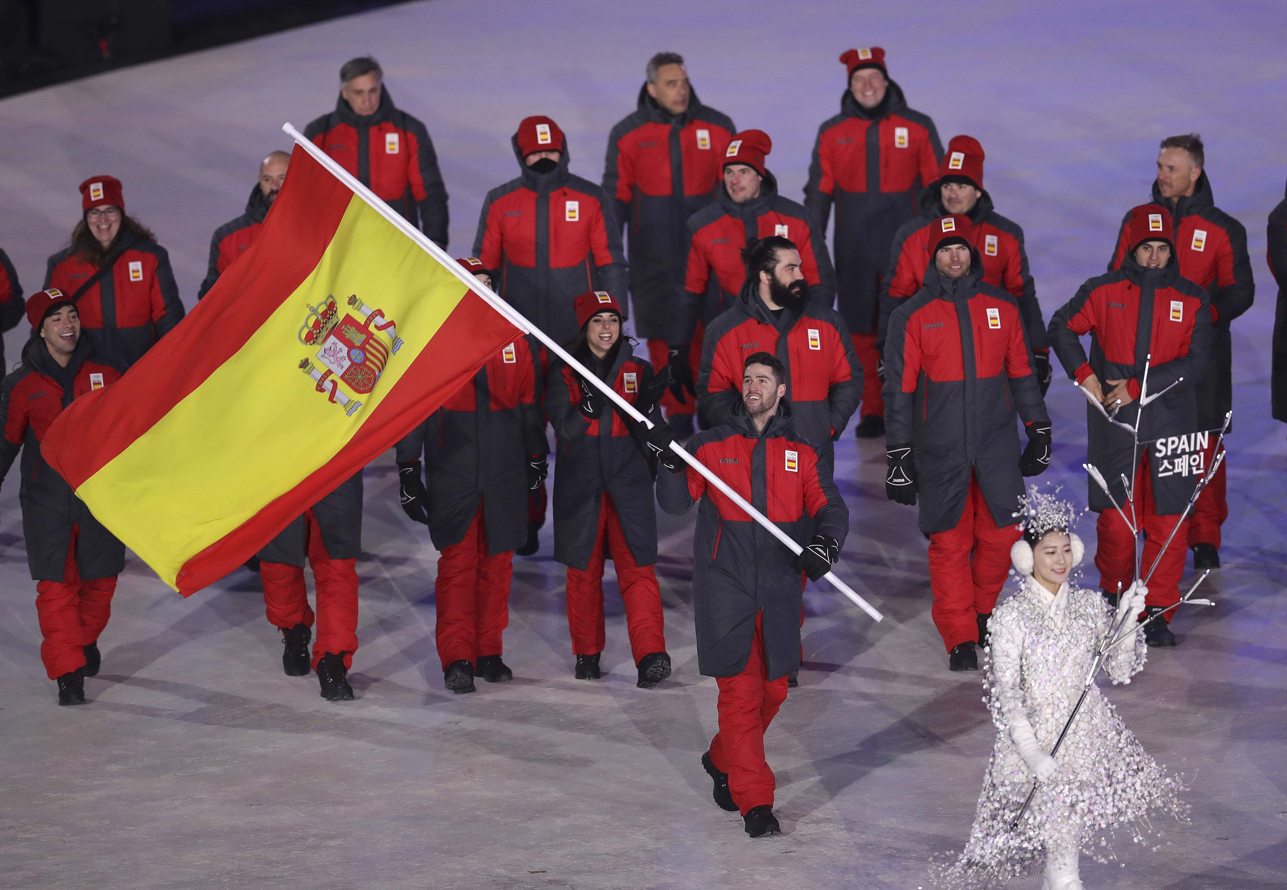Lucas Eguibar carries the flag of Spain during the opening ceremony of the 2018 Winter Olympics in Pyeongchang, South Korea, Friday, Feb. 9, 2018. (AP Photo/Michael Sohn)