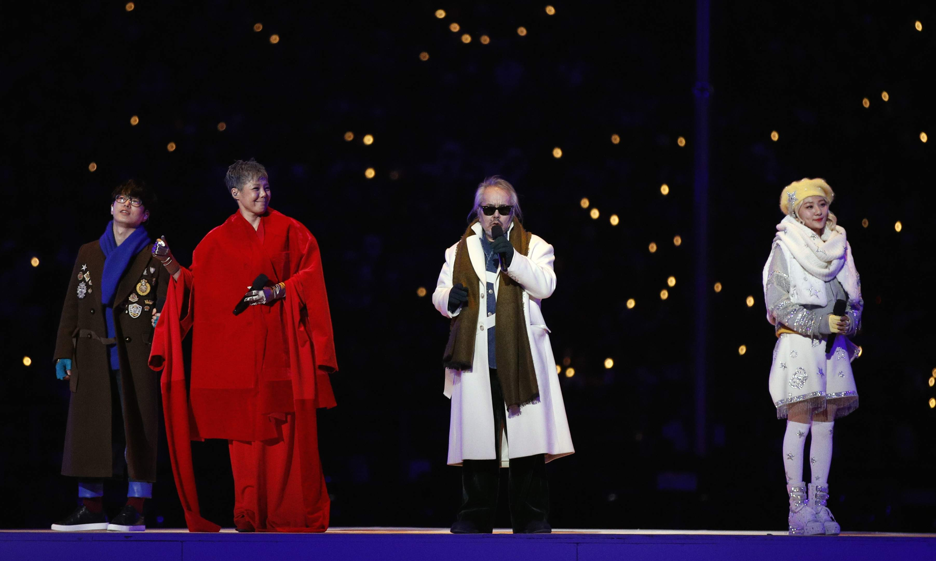 Singers from left Ha Hyun-woo, Lee Eun-mi, Jeon In-kwon and Ahn Ji-young perform during the opening ceremony of the 2018 Winter Olympics in Pyeongchang, South Korea, Friday, Feb. 9, 2018. (AP Photo/Jae C. Hong)