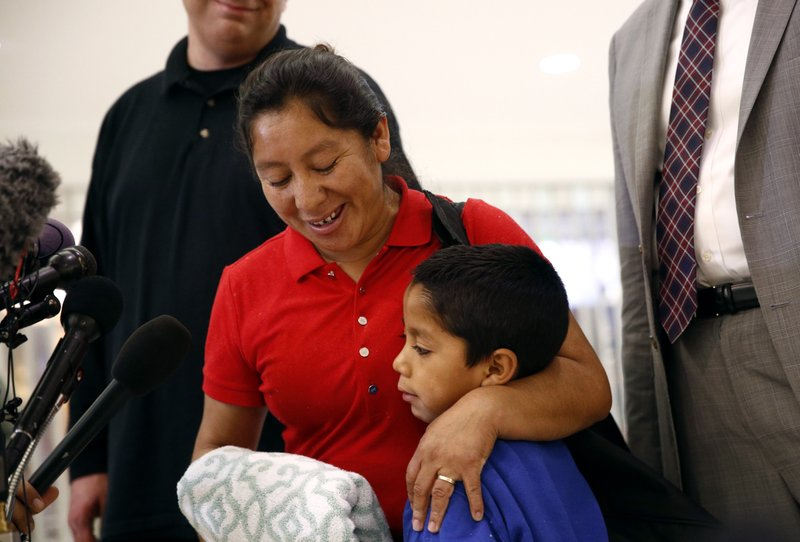 Beata Mariana de Jesus Mejia-Mejia, left, embraces her son Darwin Micheal Mejia as she speaks at a news conference following their reunion at Baltimore-Washington International Thurgood Marshall Airport, Friday, June 22, 2018, in Linthicum, Md. The Justice Department agreed to release Mejia-Mejia's son after she sued the U.S. government in order to be reunited following their separation at the U.S. border. She has filed for political asylum in the U.S. following a trek from Guatemala. (AP Photo/Patrick Semansky)<p></p>