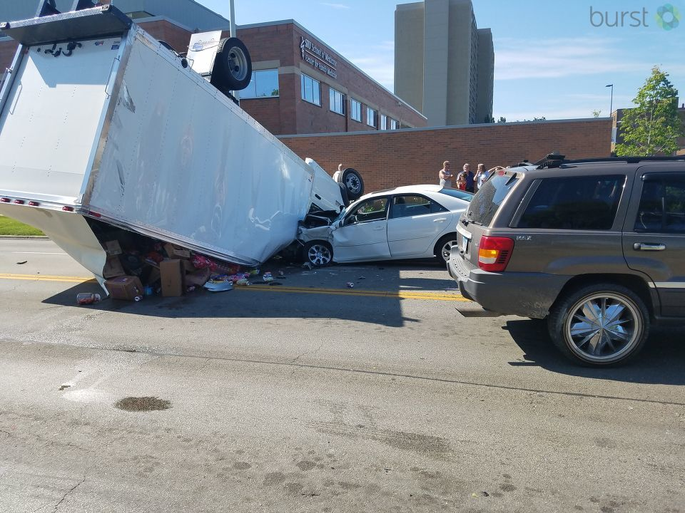 A truck carrying soda has flipped in downtown Springfield at the intersection of East Carpenter Street & North 4th Street. (Photojournalist Andrew Rutherford)