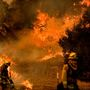Crews struggle to keep flames from California neighborhoods