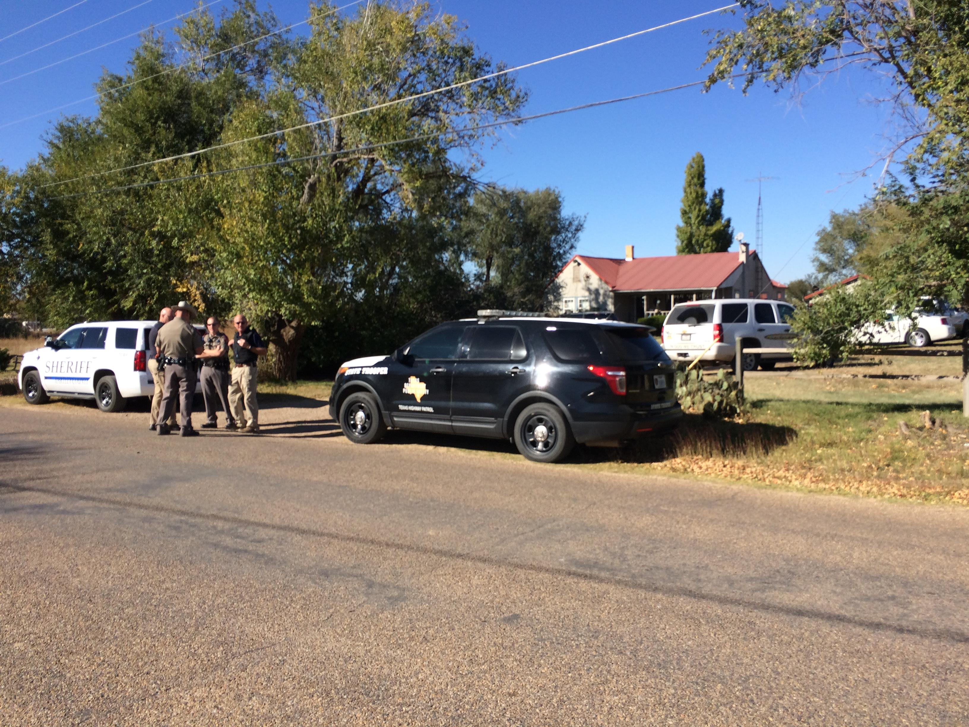 Local, state and federal law enforcement agencies search the home of Joel Frazier on Thirteenth St. in Dalhart. (ABC 7 Amarillo-Drew Powell)<p></p>