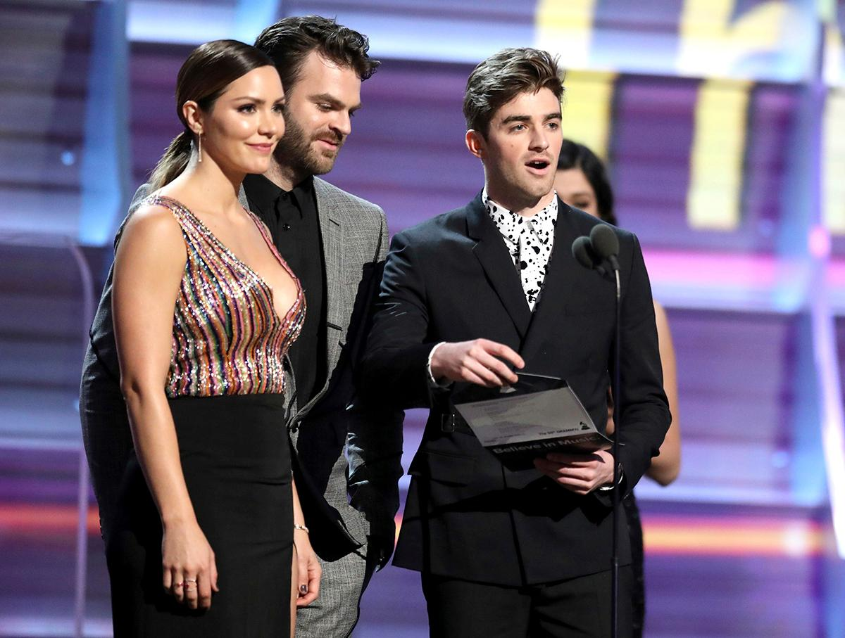 "Katharine McPhee, from left, Alex Pall and Andrew Taggart of ""The Chainsmokers"" present the award for best rock song at the 59th annual Grammy Awards on Sunday, Feb. 12, 2017, in Los Angeles. (Photo by Matt Sayles/Invision/AP)"