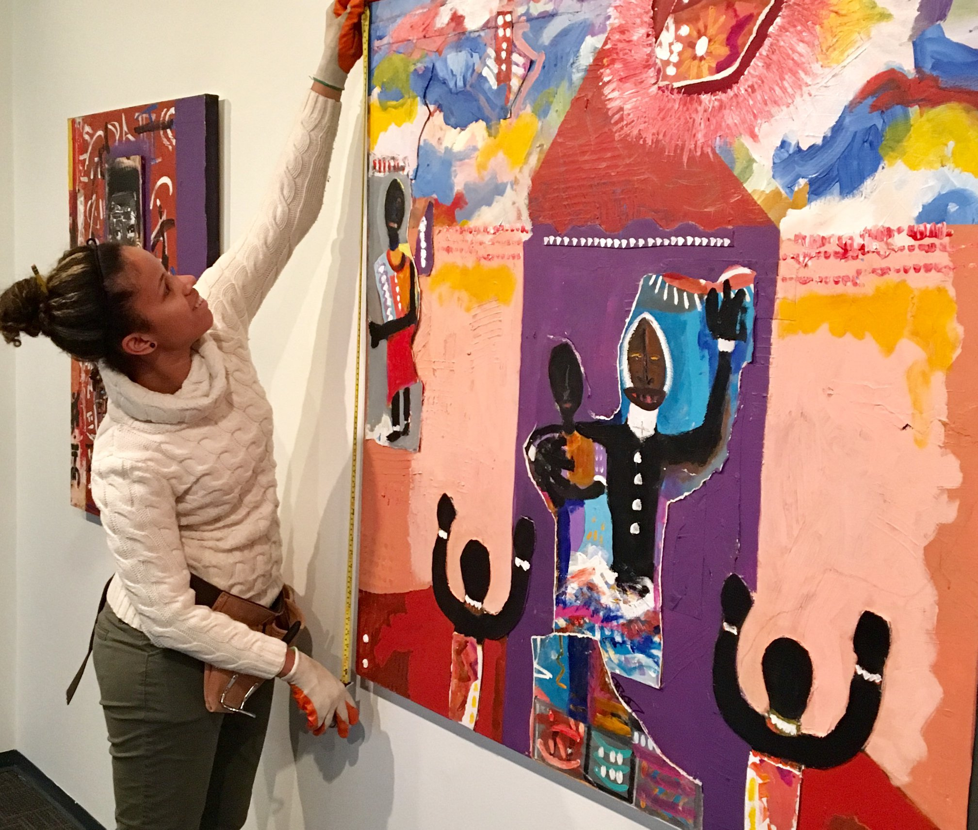 Guest Curator, Natalie Fulgencio, installing &quot;Give Me A Peace of Mind&quot;, a new exhibit in Annapolis from artist Ulysses Marshall (Image: Banneker-Douglass Museum<p></p>