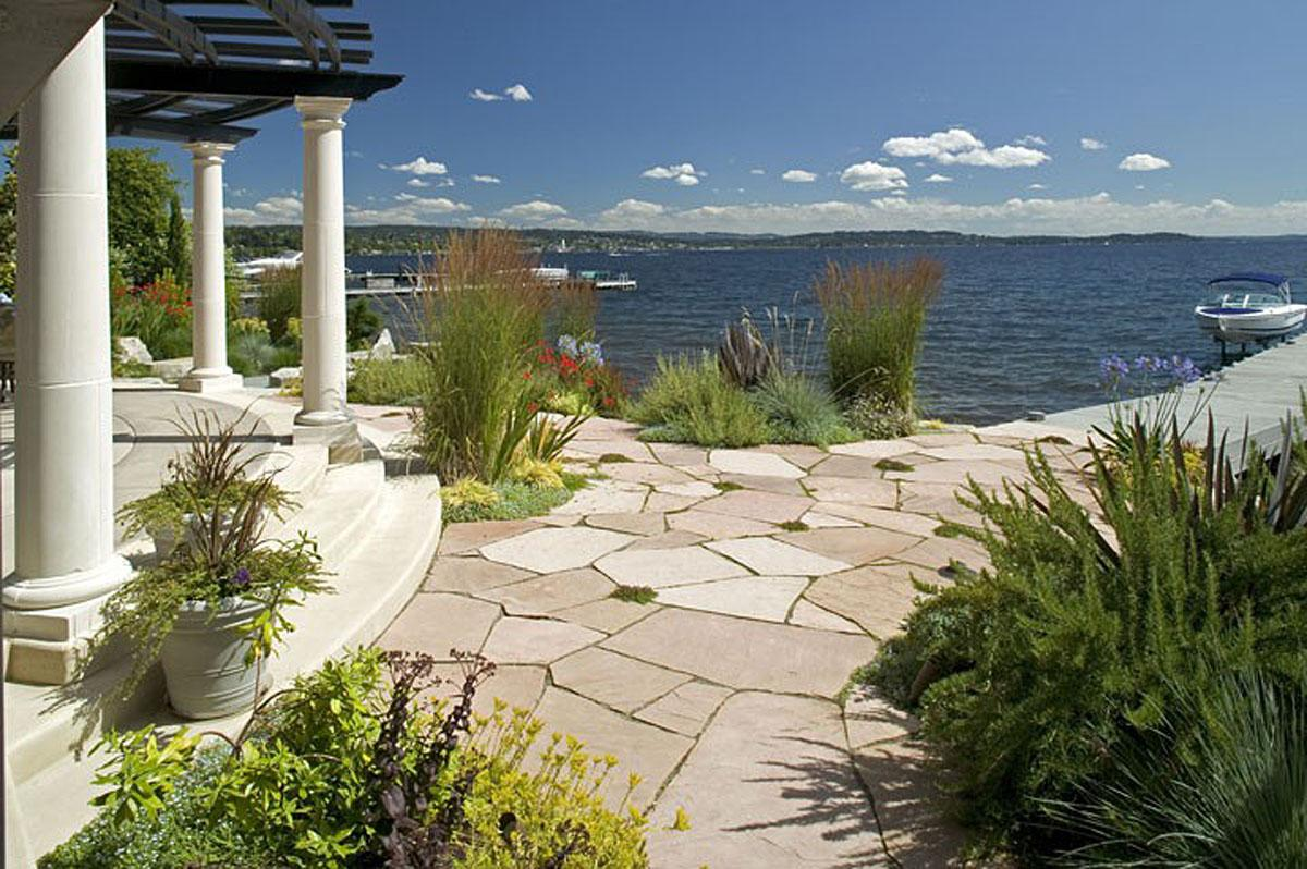 This Italian Waterfront project in Kirkland was completed by Darwin Webb Landscape Architects, P.S. The project cost $250,000.   (Image: Italian Waterfront / Porch.com)