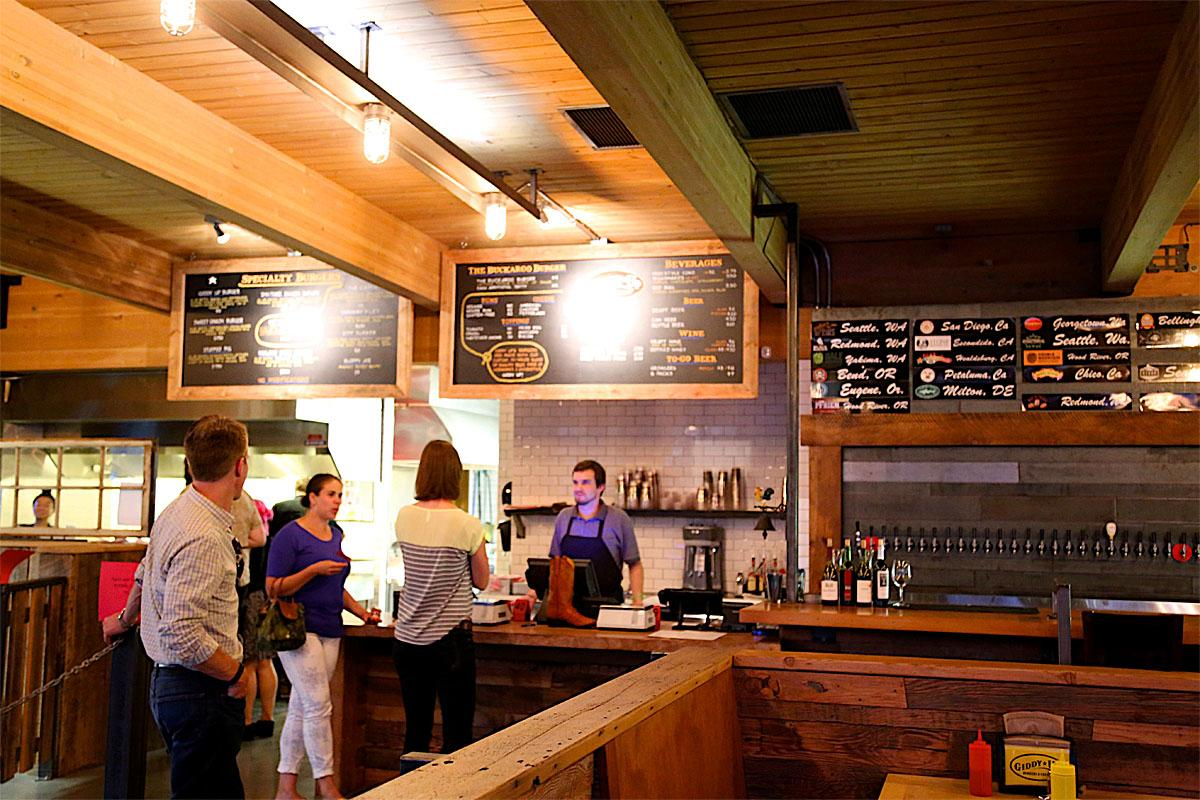 Giddy Up Burgers & Greens opened Monday, August 18th in Ballard. Primarily serving craft burgers and beer, Giddy Up also has a pay-per-pound salad bar a la Whole Foods. (Image: Kristi Waite/Seattle Refined)