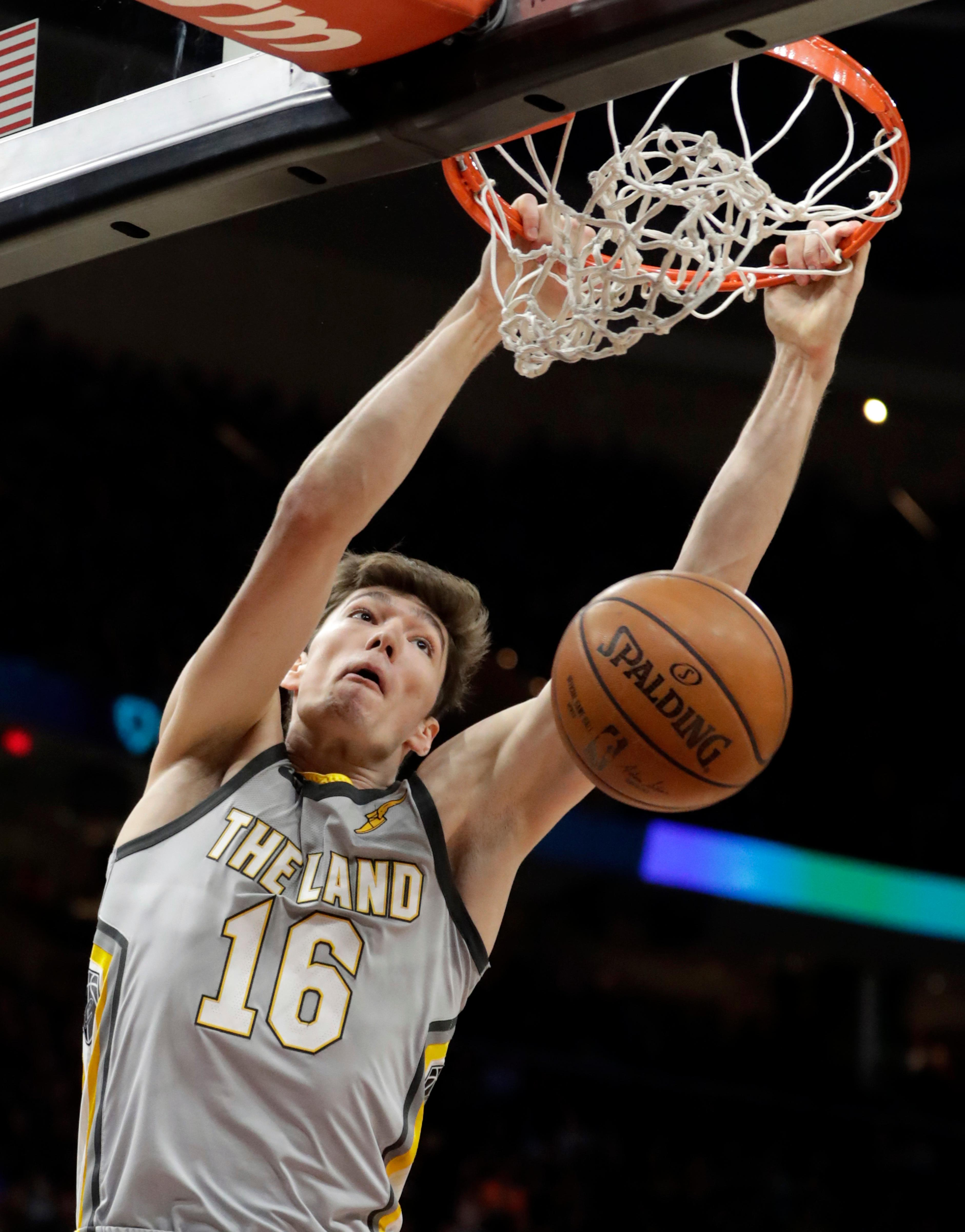 Cleveland Cavaliers' Cedi Osman, from Turkey, dunks the ball against the Denver Nuggets in the first half of an NBA basketball game, Saturday, March 3, 2018, in Cleveland. (AP Photo/Tony Dejak)