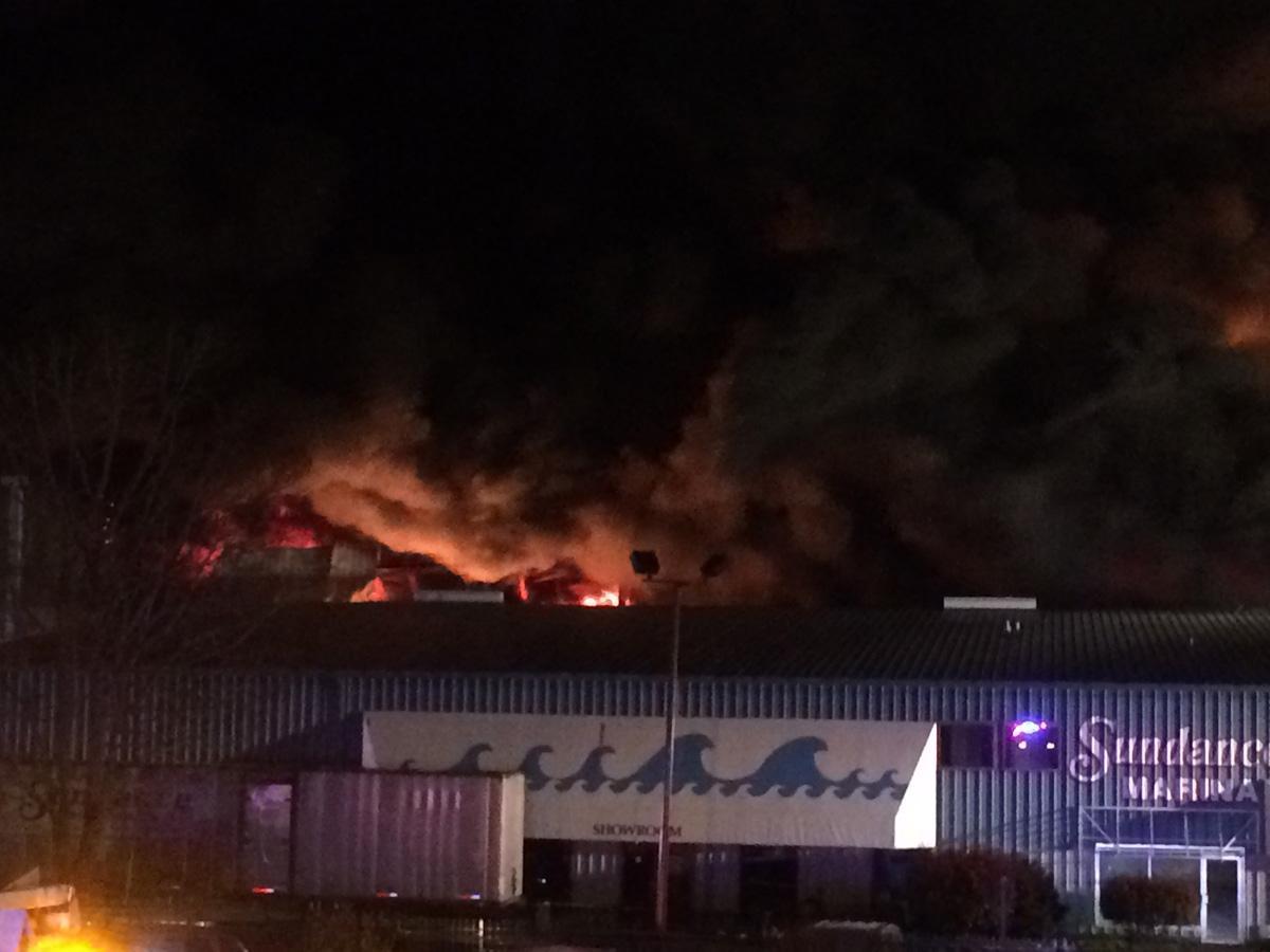 massive fire destroys marina building that stores around