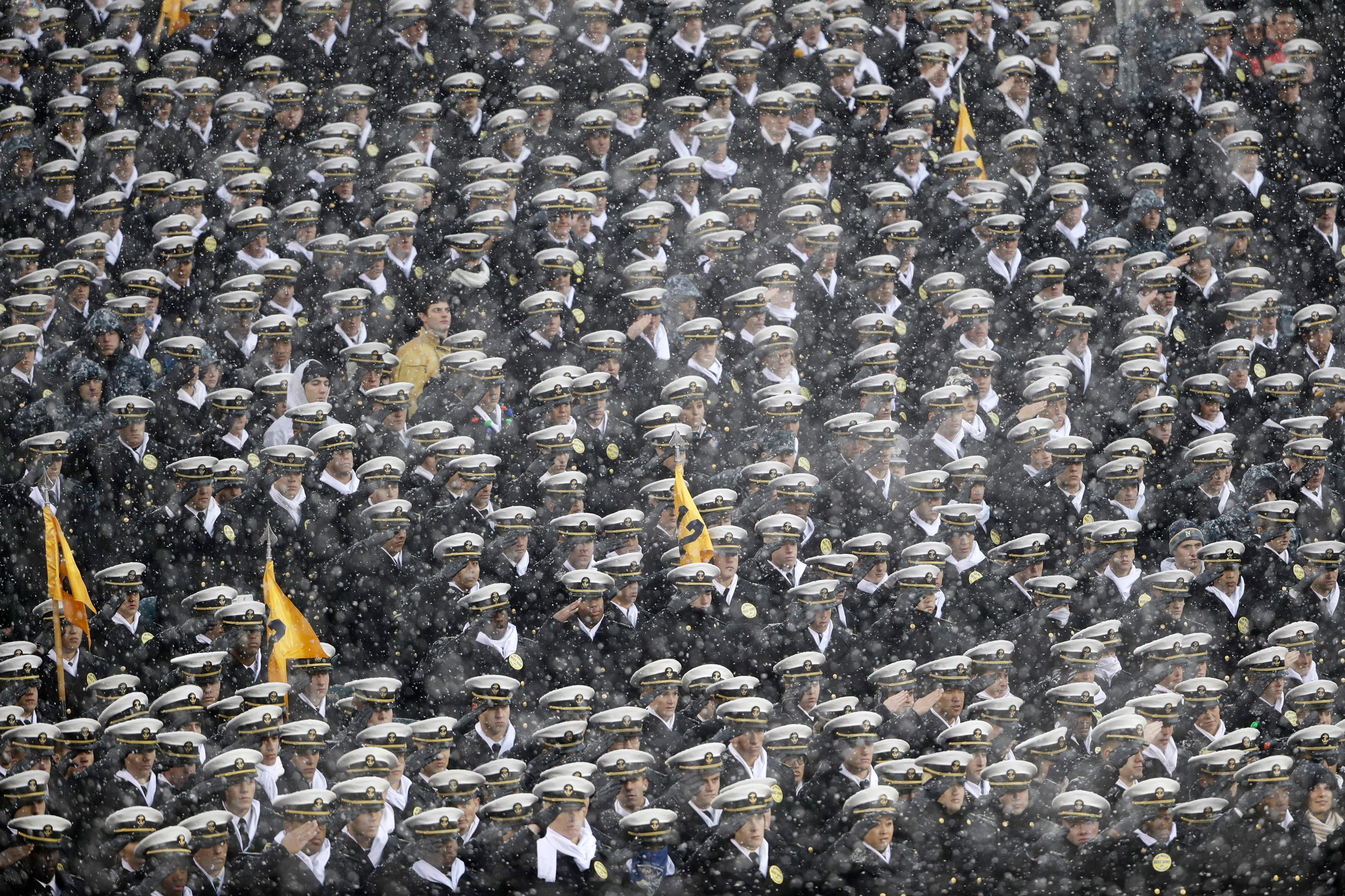 Navy Midshipmen salute during the National Anthem ahead an NCAA college football game between the Army and the Navy, Saturday, Dec. 9, 2017, in Philadelphia. (AP Photo/Matt Rourke)