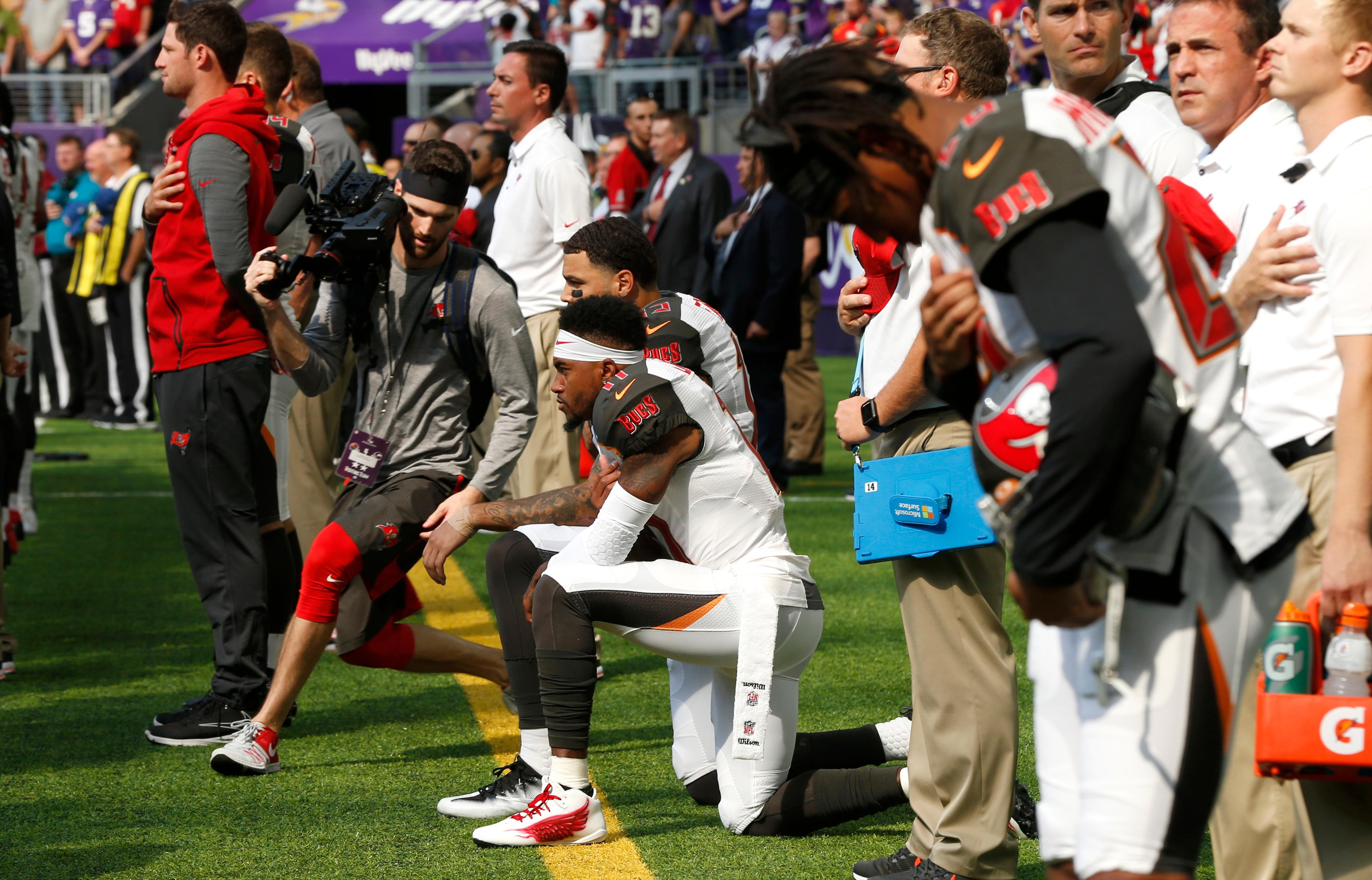 Tampa Bay Buccaneers wide receiver DeSean Jackson, center, takes a knee during the national anthem before an NFL football game against the Minnesota Vikings, Sunday, Sept. 24, 2017, in Minneapolis. (AP Photo/Jim Mone)
