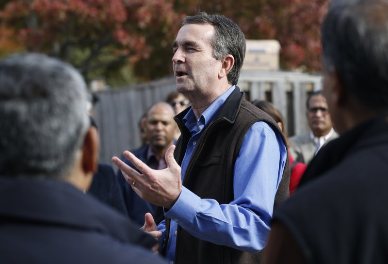Democratic gubernatorial candidate Lt. Gov. Ralph Northam talks with volunteers at a canvas kickoff site in Sterling, Va., Saturday, Nov. 4, 2017. Northam faces Republican challenger Ed Gillespie in the Nov. 7th election. (AP Photo/Steve Helber)<p></p>