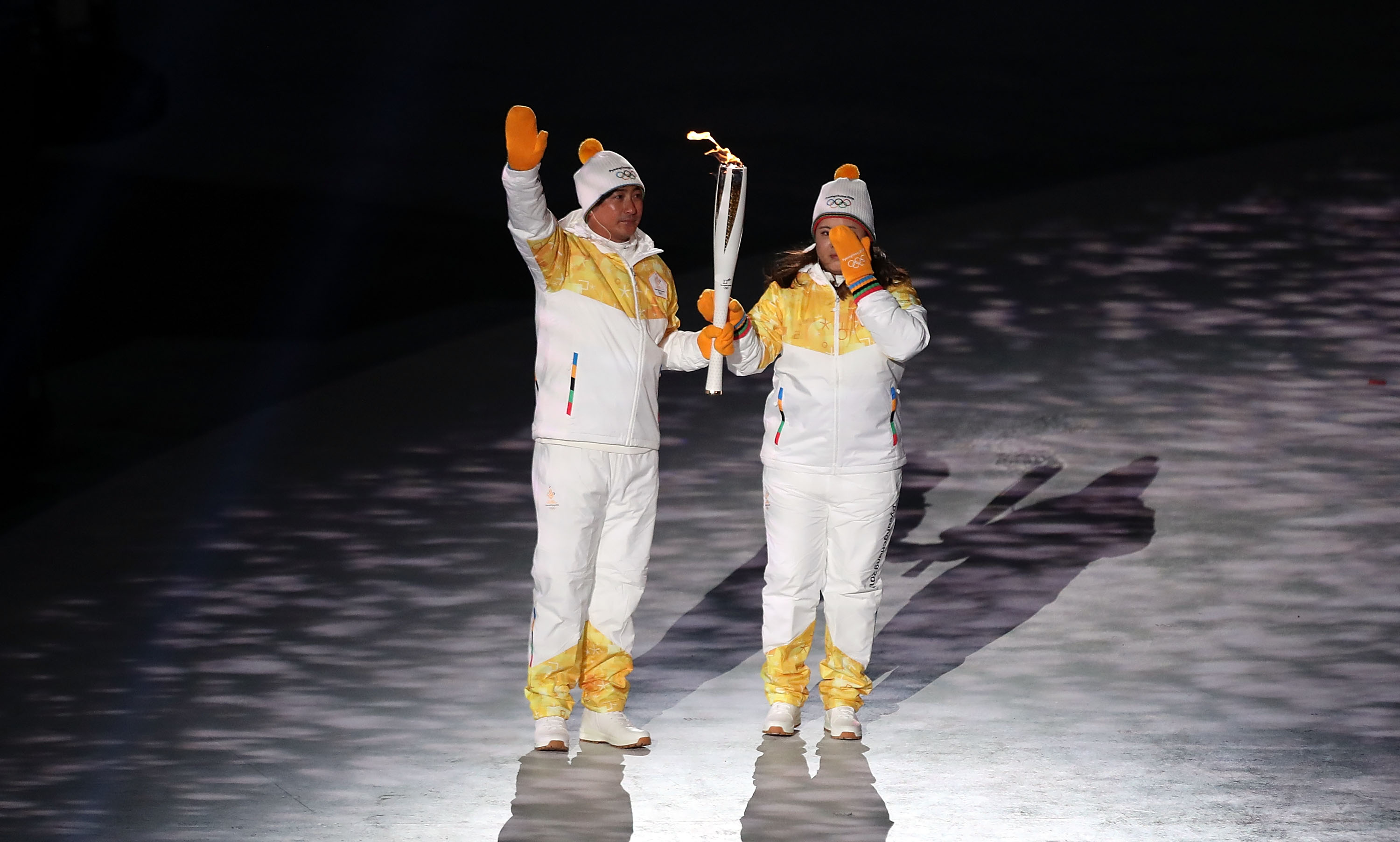 PYEONGCHANG-GUN, SOUTH KOREA - FEBRUARY 09:  The Olympic torch is carried to the cauldron during the Opening Ceremony of the PyeongChang 2018 Winter Olympic Games at PyeongChang Olympic Stadium on February 9, 2018 in Pyeongchang-gun, South Korea.  fee liable image, copyright © ATP  Amin JAMALI  XXIII. OLYMPIC WINTER GAMES PYEONGCHANG 2018: OPENING CEREMONY,  PyeongChang, Korea, Winter Olympics; PyeongChang Olympic Stadium, on 9. February 2018, fee liable image, copyright © ATP / Amin JAMALI  Featuring: The Olympic torch is carried to the cauldron Where: Pyeongchang, Gangwon Province, South Korea When: 09 Feb 2018 Credit: ATP/WENN.com  **Not available for publication in Germany or France. No Contact Music.**