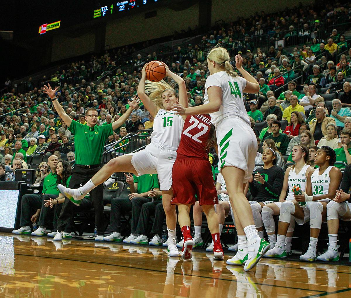 Oregon Ducks Anneli Maley (#15) pulls the ball away from Washington State University Cougars Pinelopi Pavlopoulou (#22). In their first conference basketball game of the season, the Oregon Women Ducks defeated the Washington State Cougars 89-56 in Matt Knight Arena Saturday afternoon. Oregon's Ruthy Hebard ran up 25 points with 10 rebounds. Sabrina Ionescu shot 25 points with five three-pointers and three rebounds. Lexi Bando added 18 points, with four three-pointers and pulled down three rebounds. Satou Sabally ended the game with 14 points with one three-pointer and two rebounds. The Ducks are now 12-2 overall with 1-0 in conference and the Cougars stand at 7-6 overall and 0-1 in conference play. The Oregon Women Ducks next play the University of Washington Huskies at 1:00 pm on Sunday. Photo by Rhianna Gelhart, Oregon News Lab