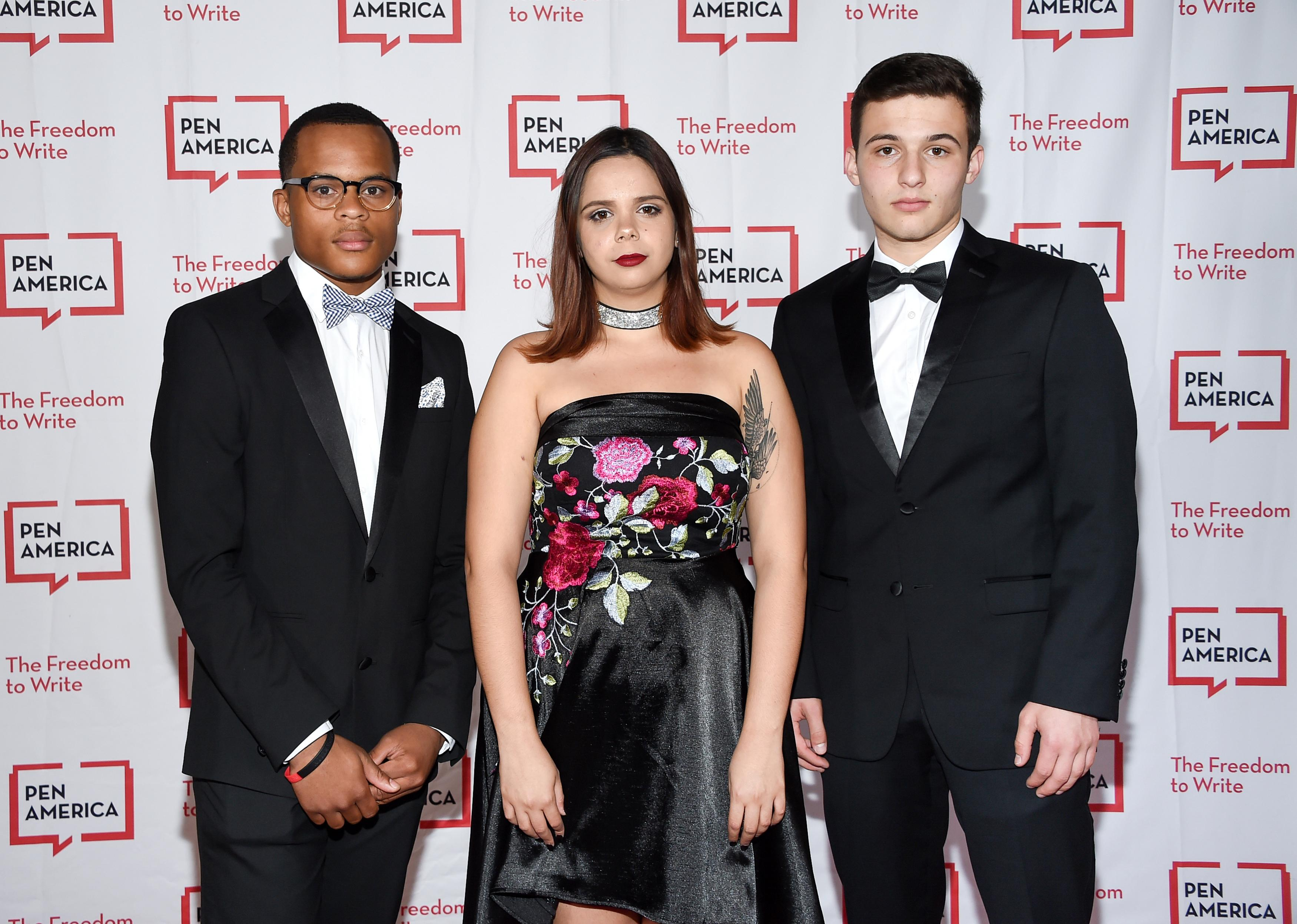 Youth anti-gun violence activist Zion Kelly, left, poses with Parkland students and youth anti-gun violence activists Samantha Fuentes and Cameron Kasky at the 2018 PEN Literary Gala at the American Museum of Natural History on Tuesday, May 22, 2018, in New York. (Photo by Evan Agostini/Invision/AP)