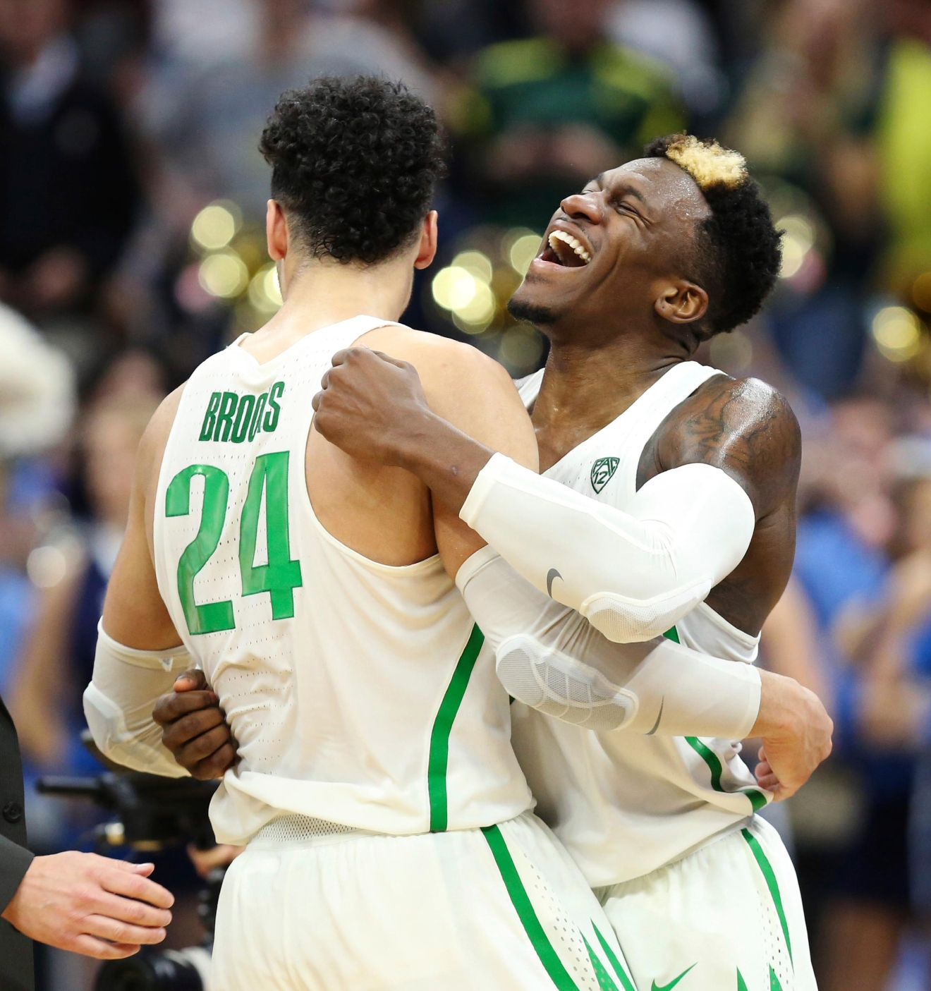 Oregon forward Dillon Brooks (24) and teammate Dylan Ennis (31) celebrate their win over Rhode Island during a second-round game in the NCAA college basketball tournament in Sacramento, Calif., Sunday, March 19, 2017. Oregon won 75-72. (AP Photo/Steve Yeater)