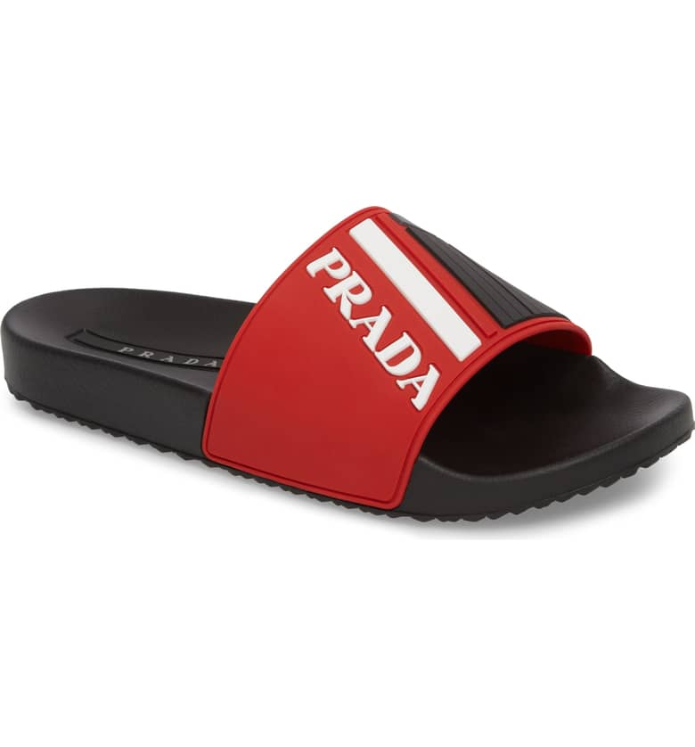 Prada Linea Rossa Logo Slide Sandal, $250.{ }The men in our lives work hard! Gift them something they'll feel appreciated in this holiday season! { }(Image courtesy of Nordstrom).