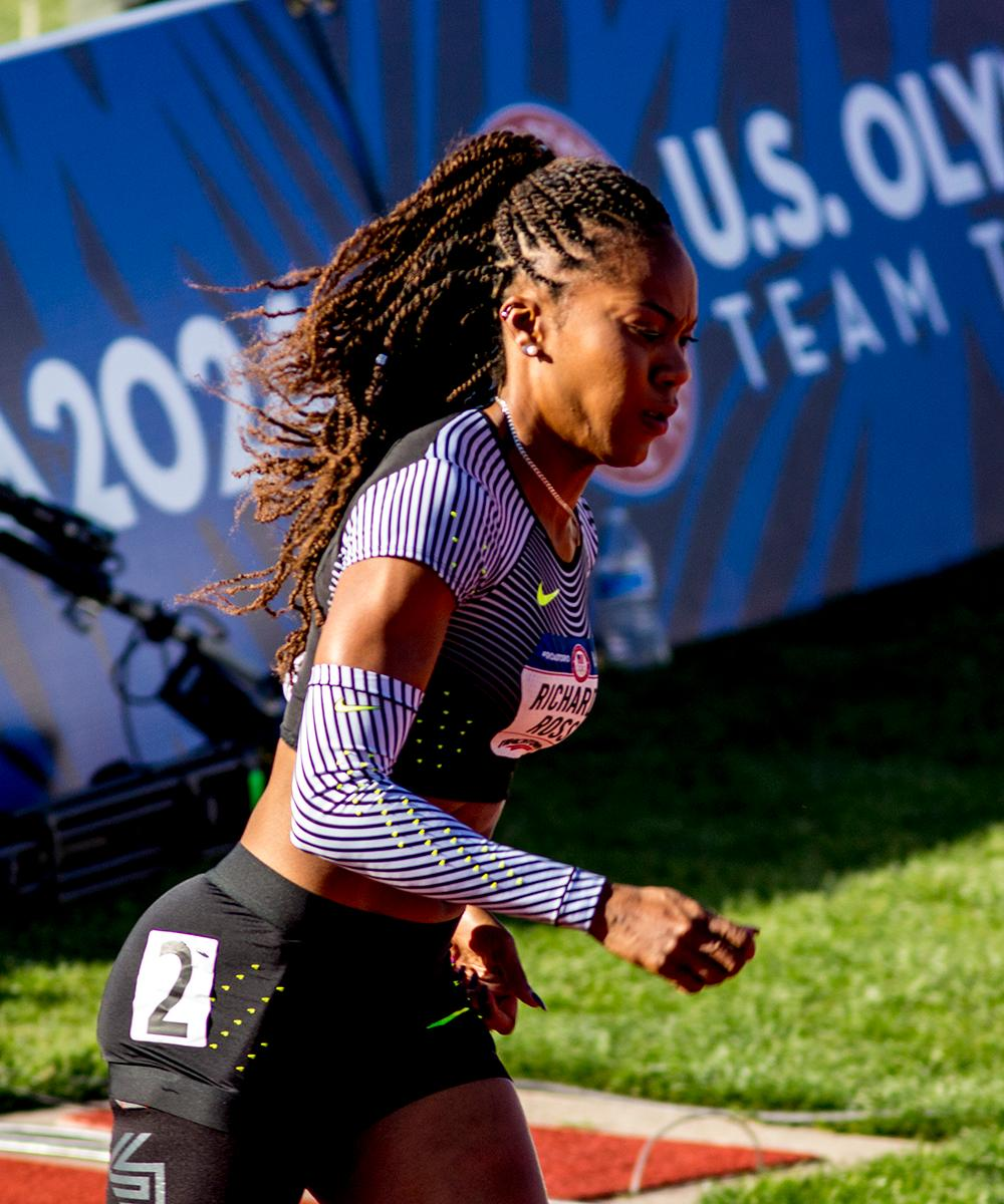 Nike�s Sanya Richards-Ross rounds the first bend in heat 3 of the Women�s 400m dash. She dropped out of the race before finishing. Day one of the U.S. Olympic Trials began on Friday at Hayward Field in Eugene, Ore. And will continue through July 10. (Photo by Amanda Butt)