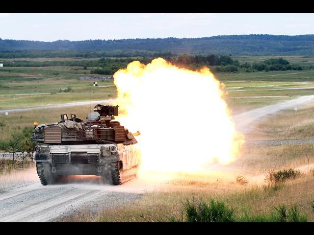 U.S. soldiers inside an Abrams M1A1 tank fire the main battle gun during Exercise Combined Resolve II at the Joint Multinational Readiness Center in Hohenfels, Germany, June 16, 2014.