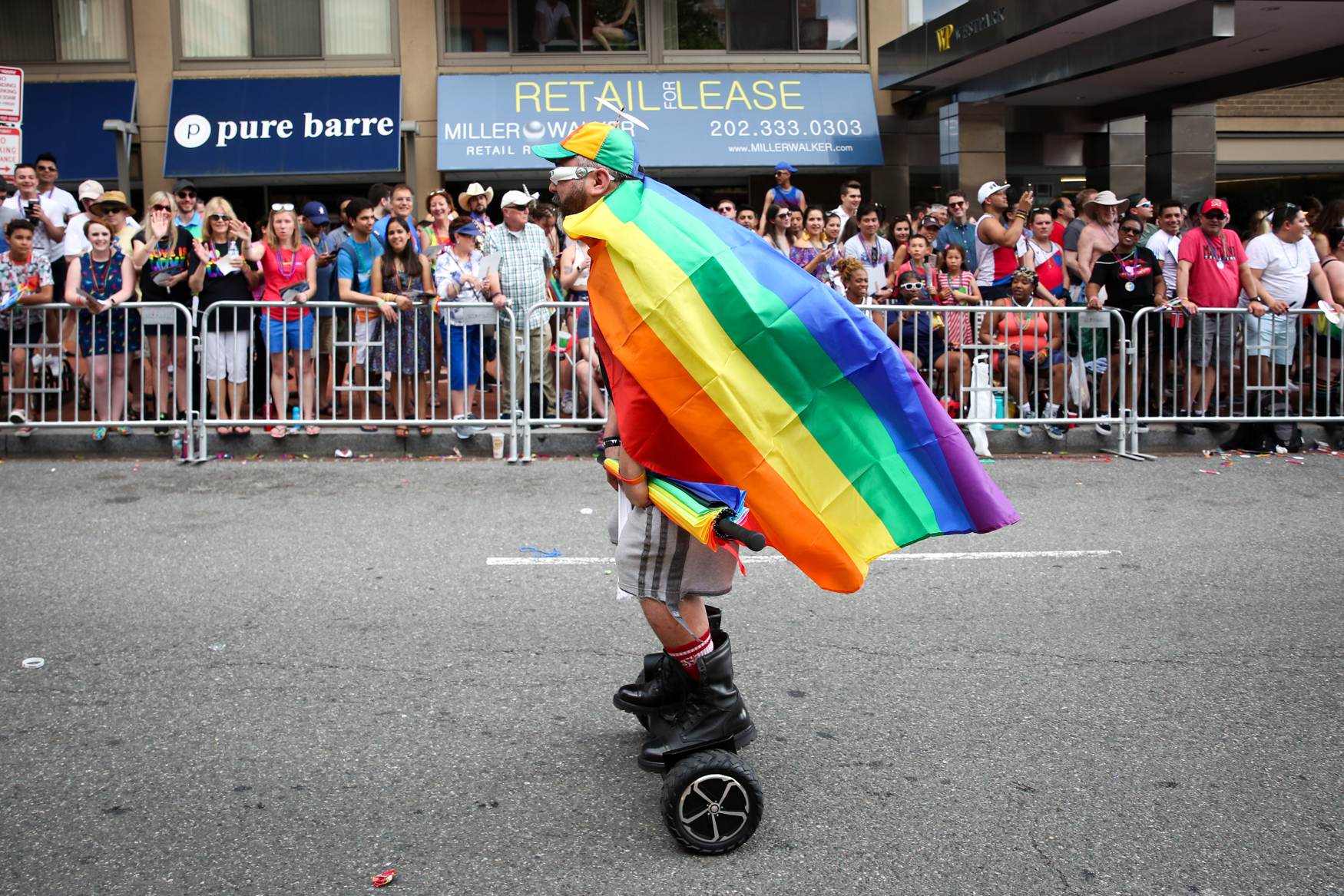 Thousands of members of the LGBTQ+ community and their allies hit the streets around Dupont Circle for the annual pride parade. Those who weren't marching cheered on the sidelines or danced in celebration of the LGBTQ+ community. (Amanda Andrade-Rhoades/DC Refined)