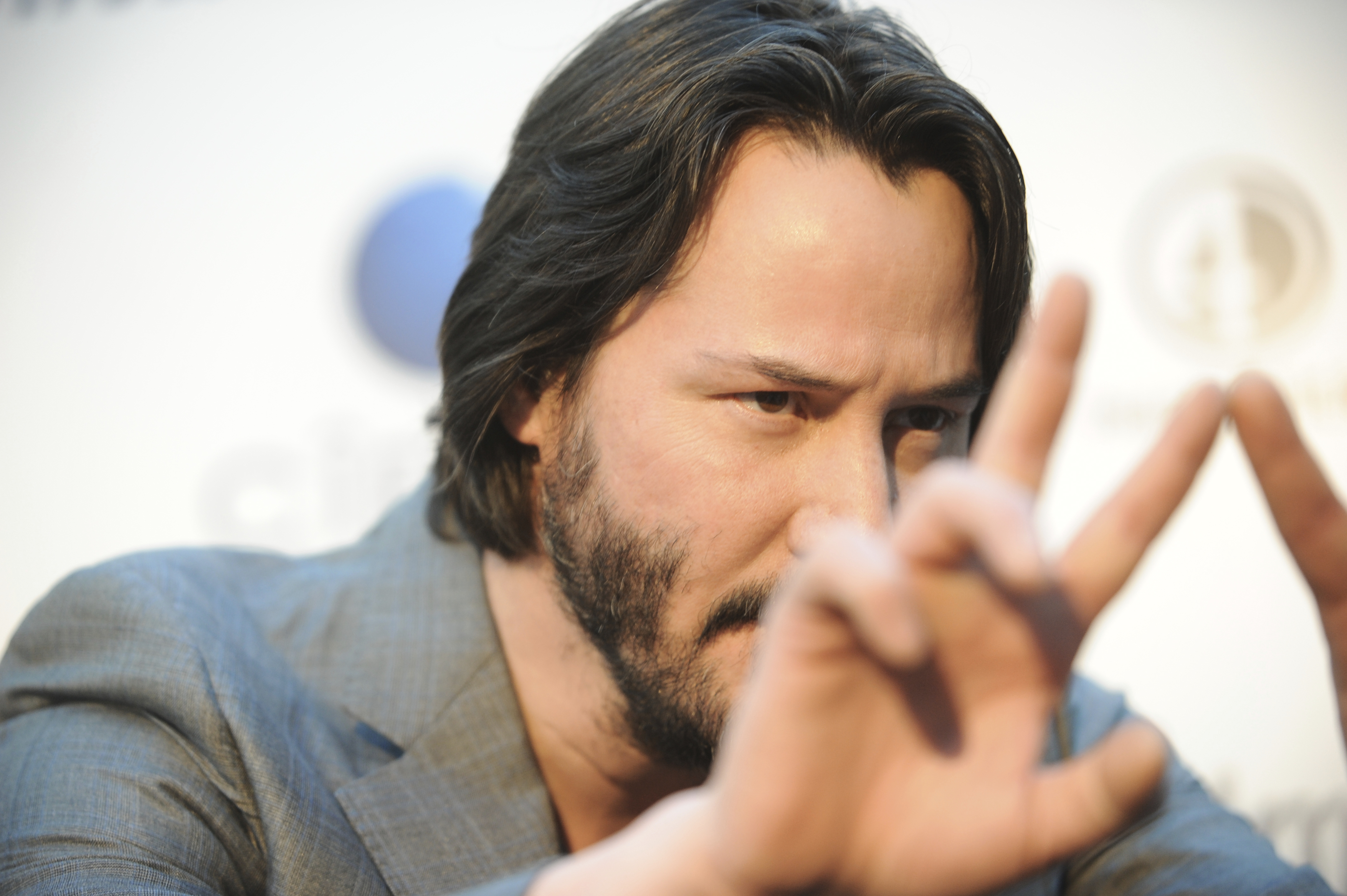 "FILE - In this May 2, 2013 file photo, Keanu Reeves arrives at the LA premiere of ""Generation Um..."" in Los Angeles. (Photo by Richard Shotwell/Invision/AP)"