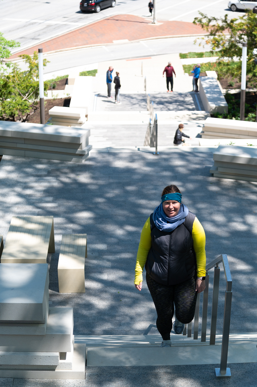 "If you travel through the intersection of Eden Park Drive and Gilbert Avenue, you'll notice the Cincinnati Art Museum has a brand new ""red carpet"" of sorts. 164 tastefully arranged steps now connect the intersection with the Art Museum's parking lot nine stories above. Known as the Art Climb, the first phase of the staircase formally opened in early May and features picnic tables, benches, and several sections with attractive views of the land below. Emersion Design and Human Nature are responsible for the architecture and landscaping. Turner Construction built the staircase. Future phases will include the addition of sculptures to the land surrounding the Art Climb. / Image: Phil Armstrong // Published: 5.11.20"