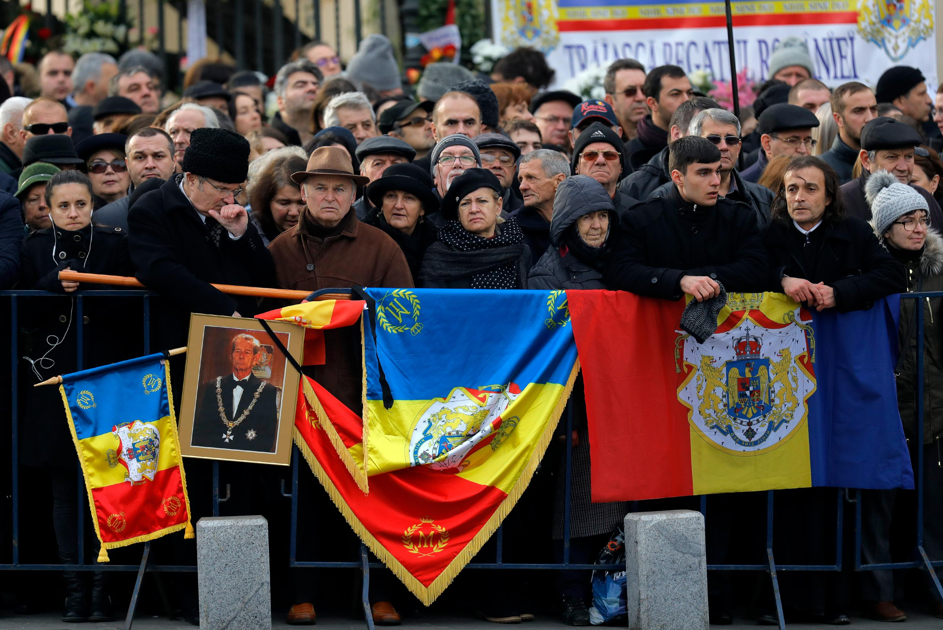 People wait outside the former royal palace to attend Romanian King Michael's funeral ceremony in Bucharest, Romania, Saturday, Dec.16, 2017. Thousands waited in line to pay their respects to Former King Michael, who ruled Romania during WWII, and died on Dec. 5, 2017, aged 96, in Switzerland. (AP Photo/Vadim Ghirda)